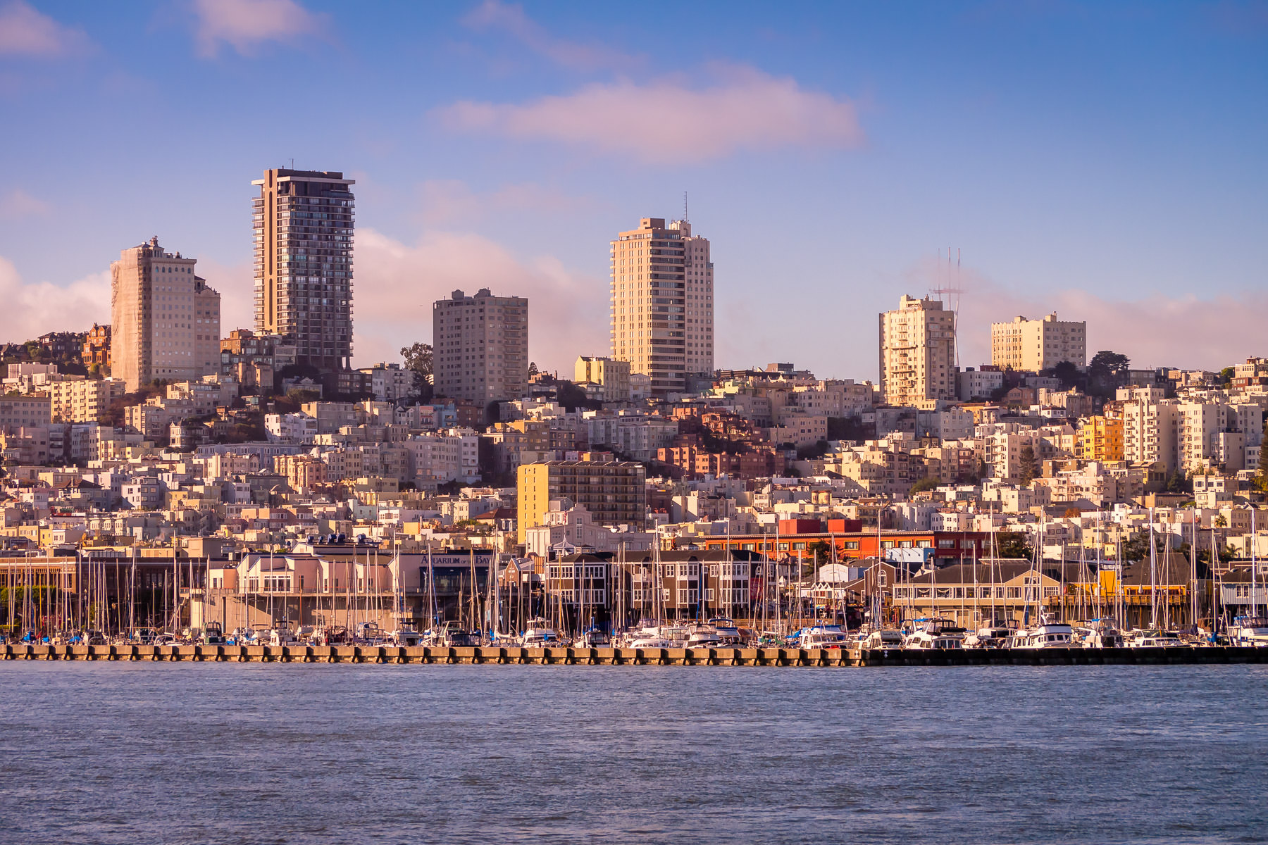 San Francisco's Russian Hill rises above the waterfront as the sun rises on the city.