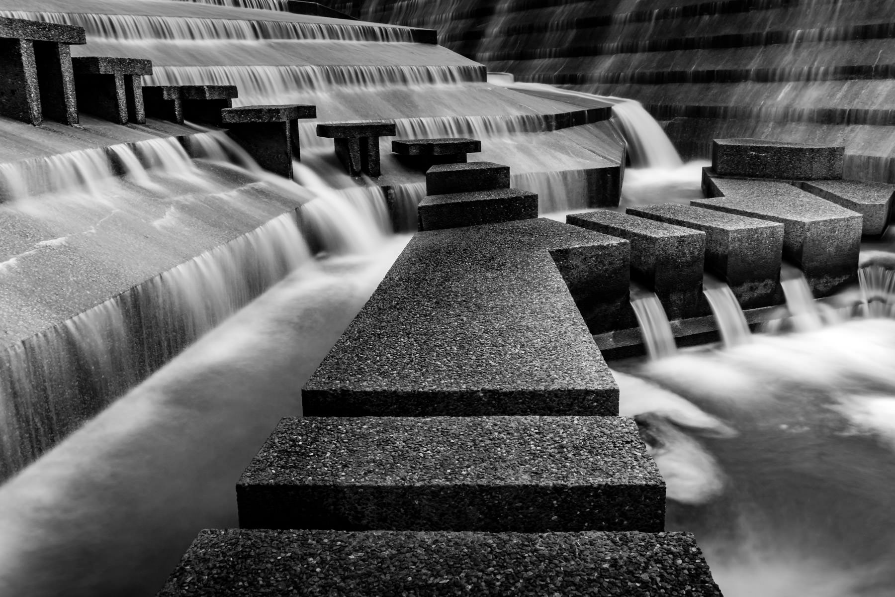 Concrete aggregate blocks form a path through the Active Pool at the Philip Johnson-designed Fort Worth Water Gardens in the south end of Downtown Fort Worth, Texas.
