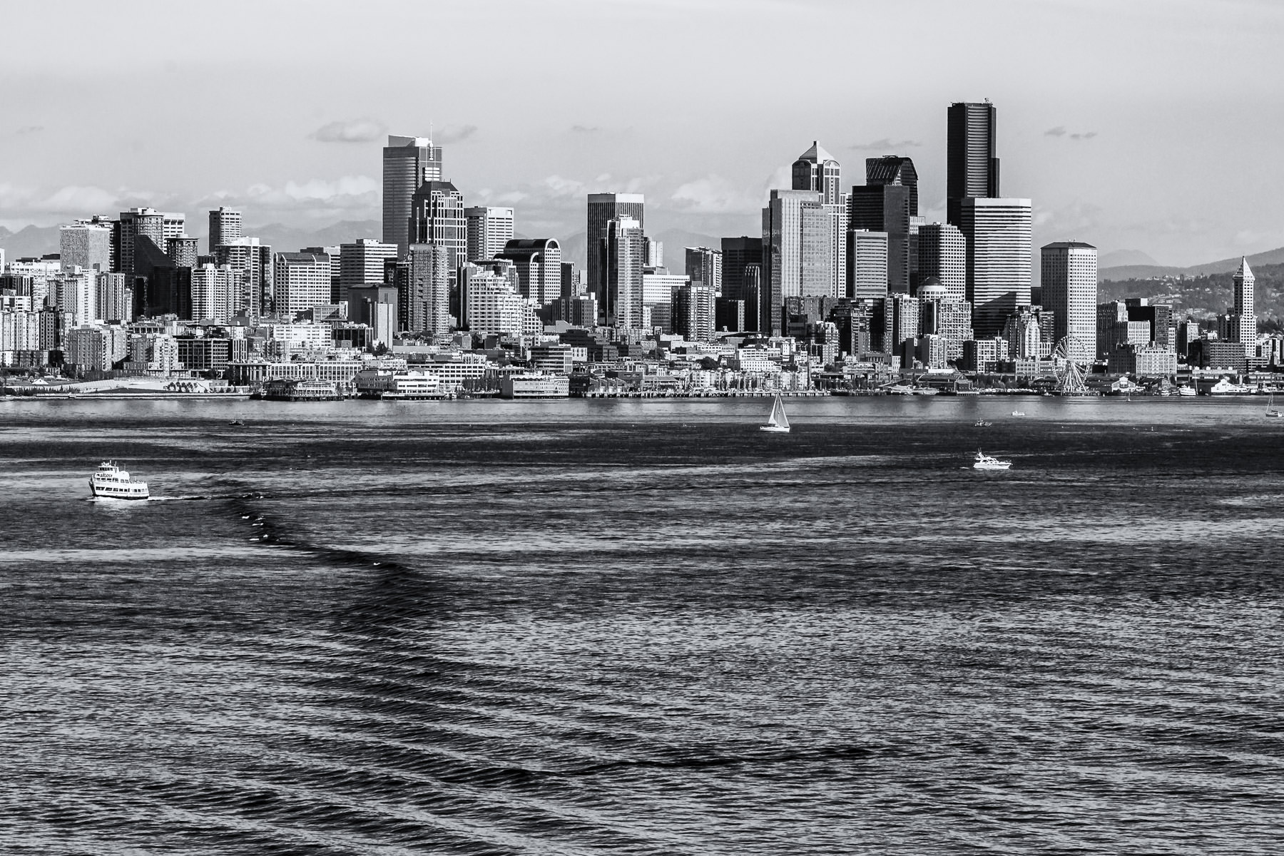 Downtown Seattle and its accompanying waterfront, as seen from some distance offshore in Elliott Bay.