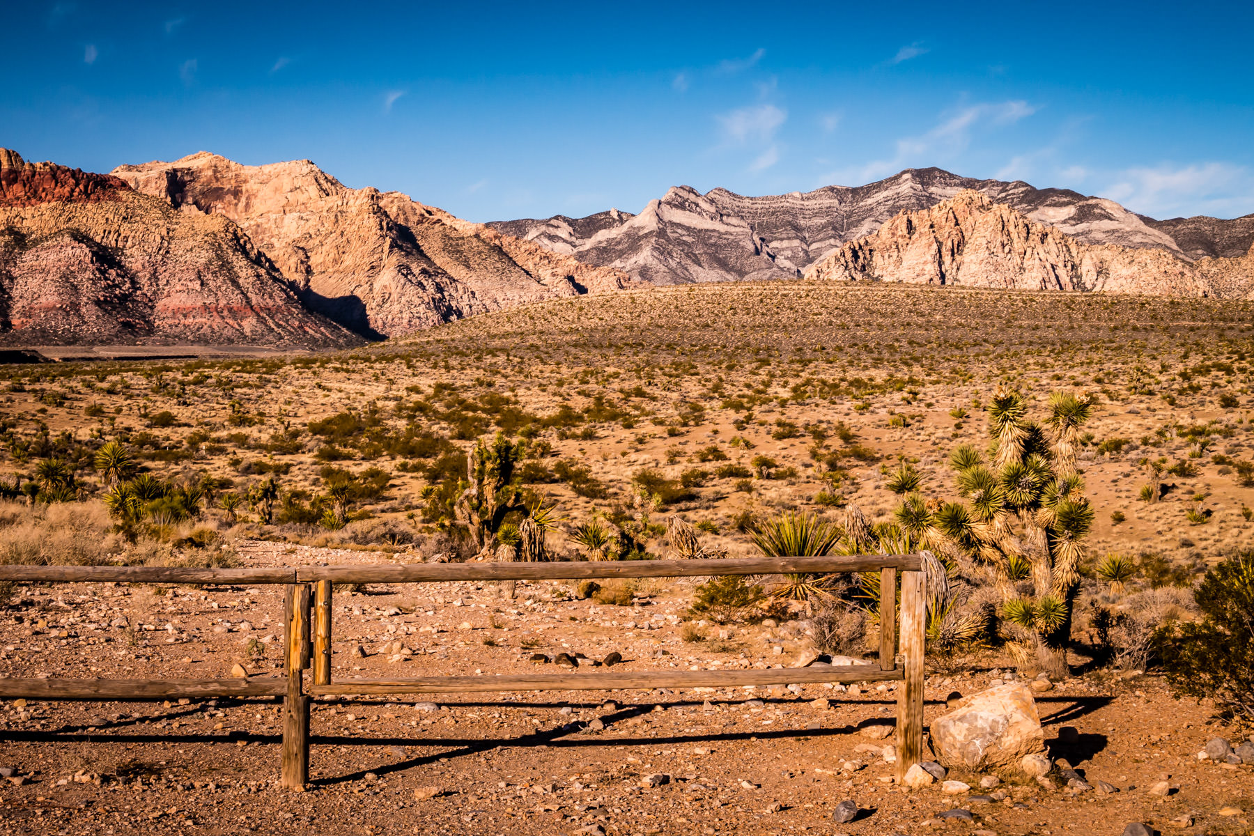 A weathered fence among the desert brush at Nevada's Red Rock Canyon.