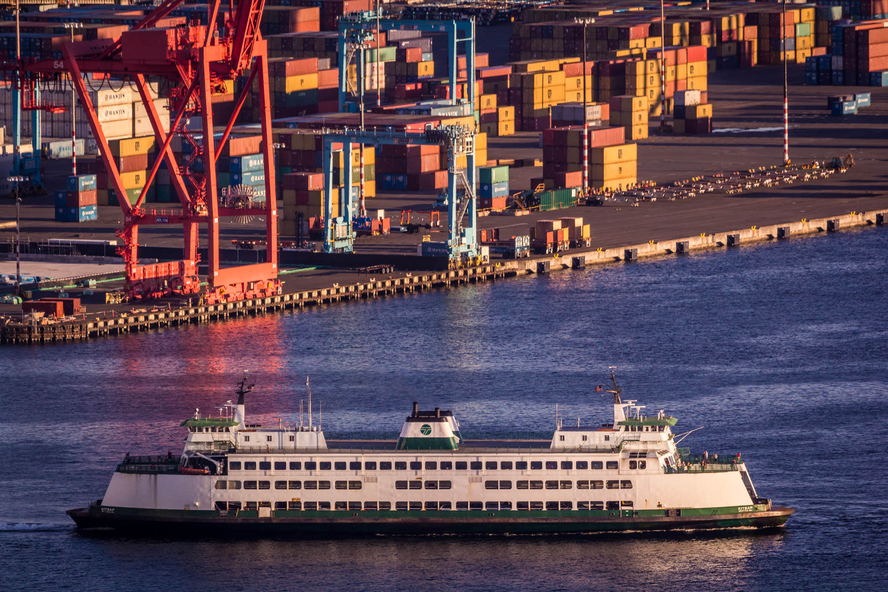 A Washington State Ferry leaves the Seattle Ferry Terminal as the sun begins to set on Puget Sound.