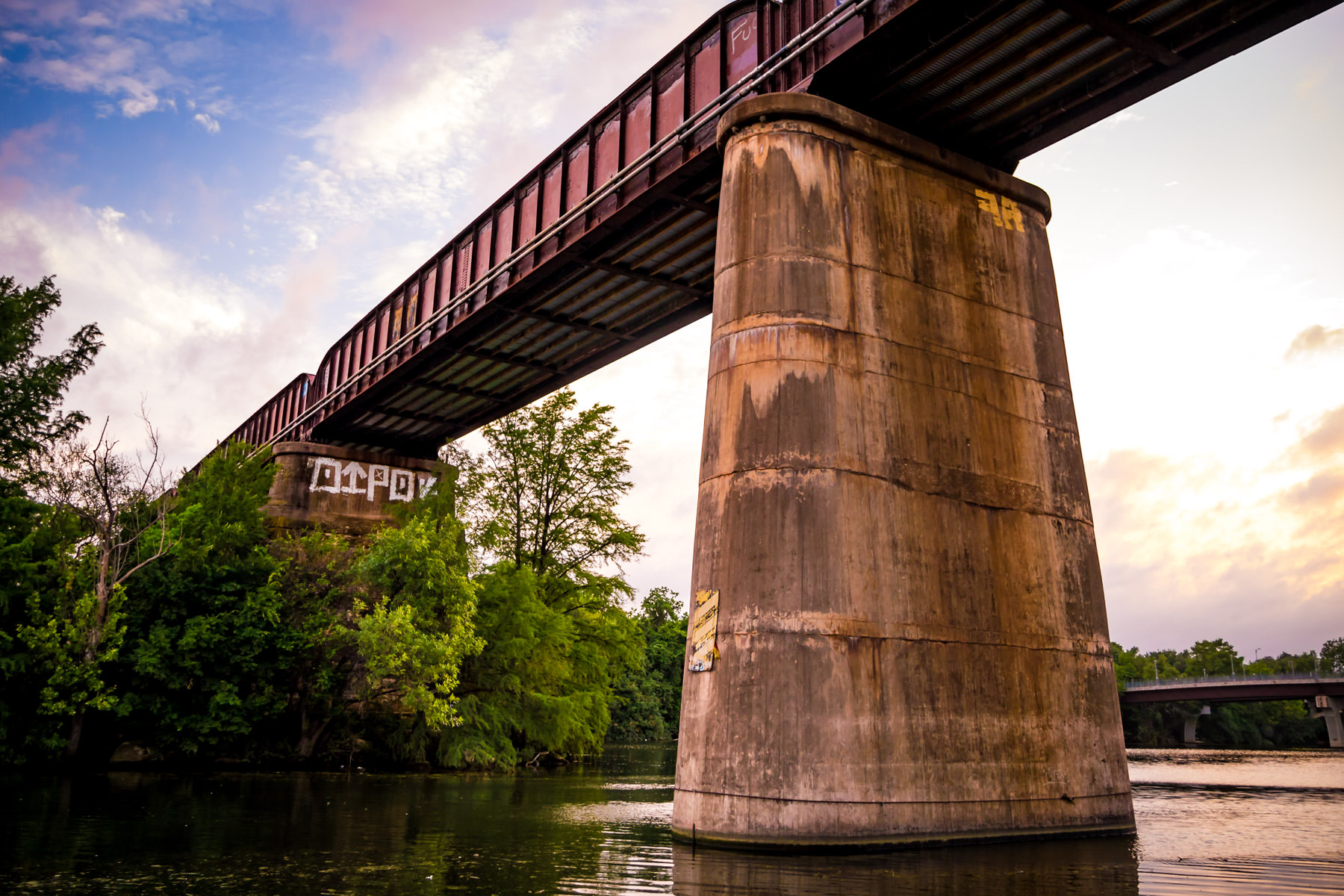The Union Pacific Railroad passes over Lady Bird Lake as the sun sets on Austin, Texas.