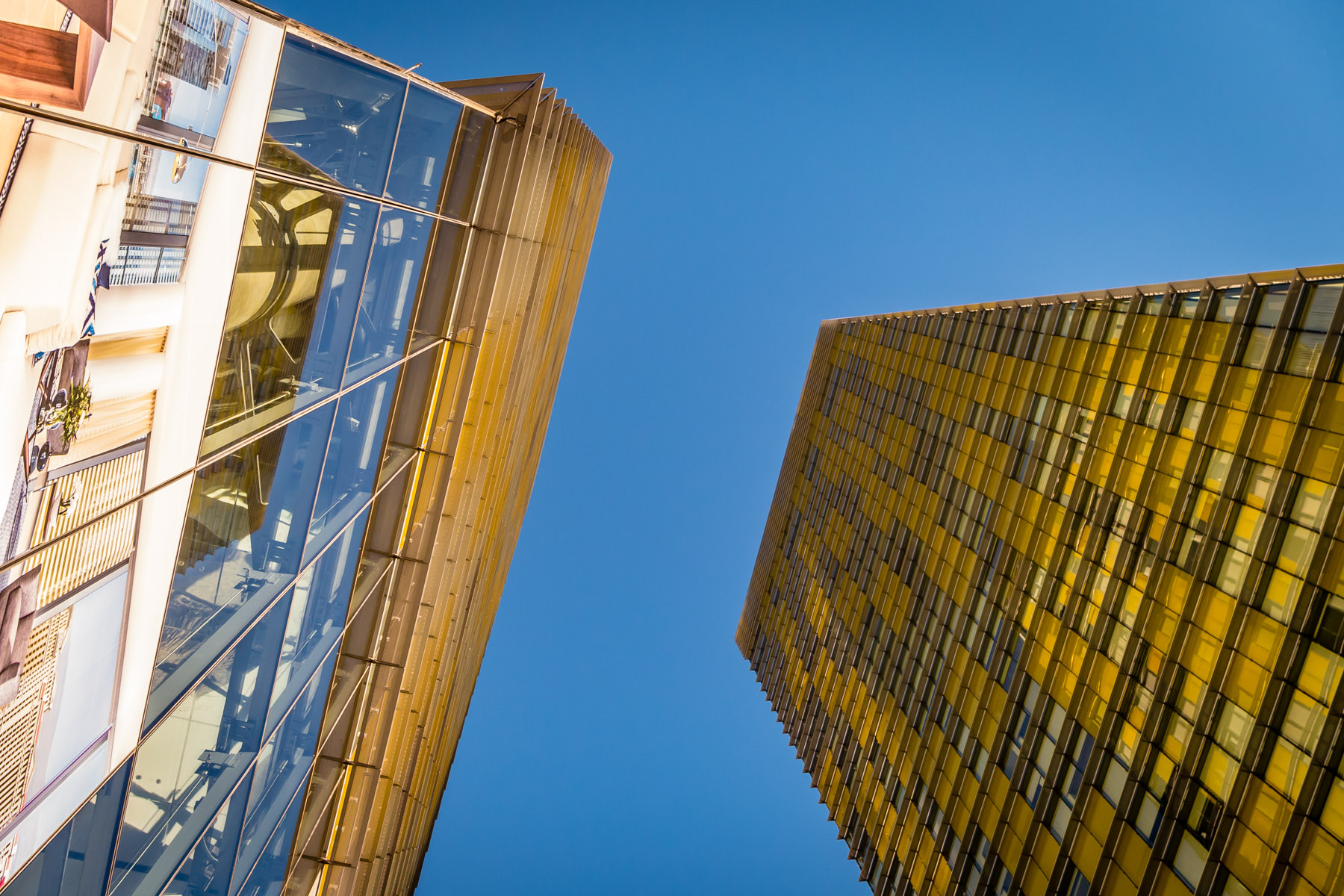 The Veer Towers at Las Vegas' CityCenter rise into the clear Nevada sky.