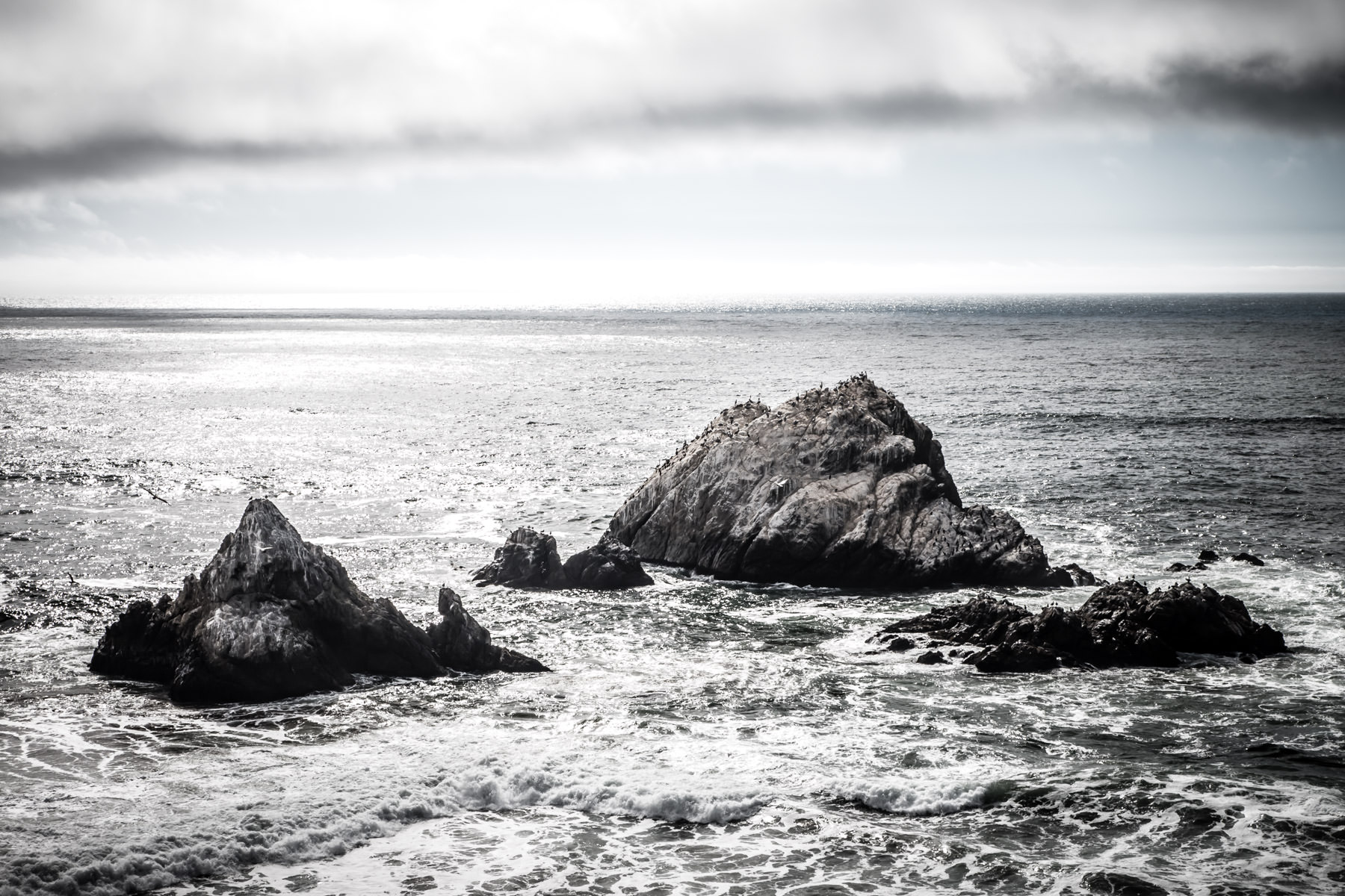 San Francisco's Seal Rocks rise from the Pacific Ocean surf just off the shore of Lands End on the western edge of the city.