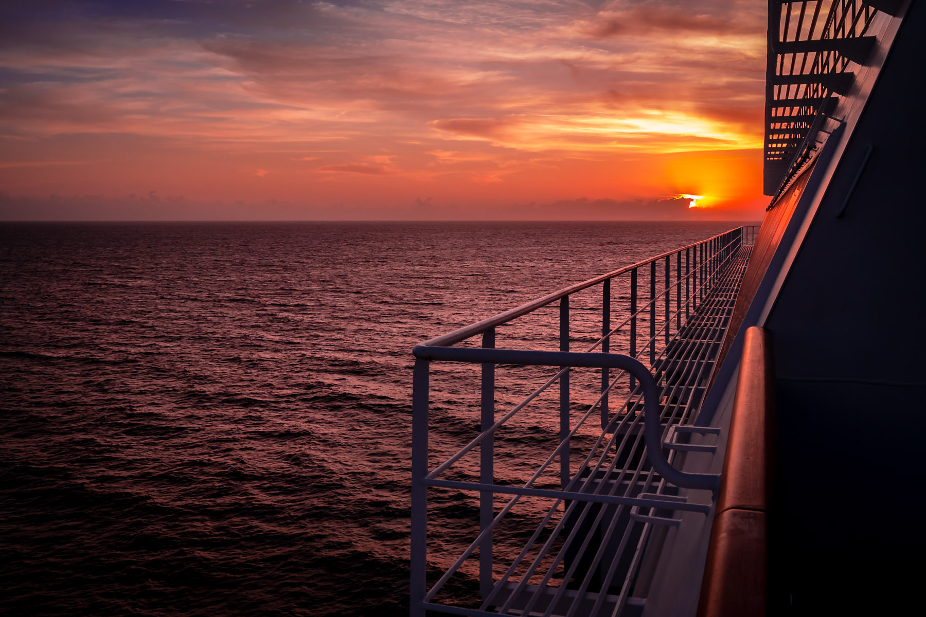 The sun rises over the Straits of Florida as seen from the cruise ship Carnival Magic.