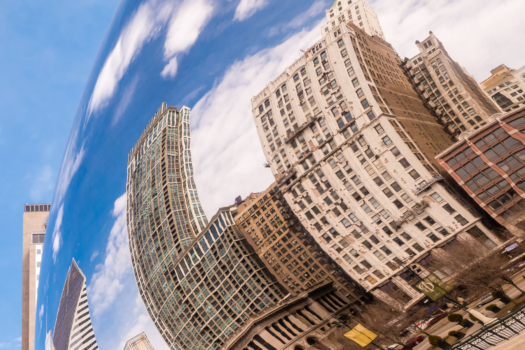"The reflections of adjacent buildings are bent and twisted in the polished stainless steel skin of Anish Kapoor's Cloud Gate, colloquially known as ""The Bean"", in Millennium Park, Chicago."