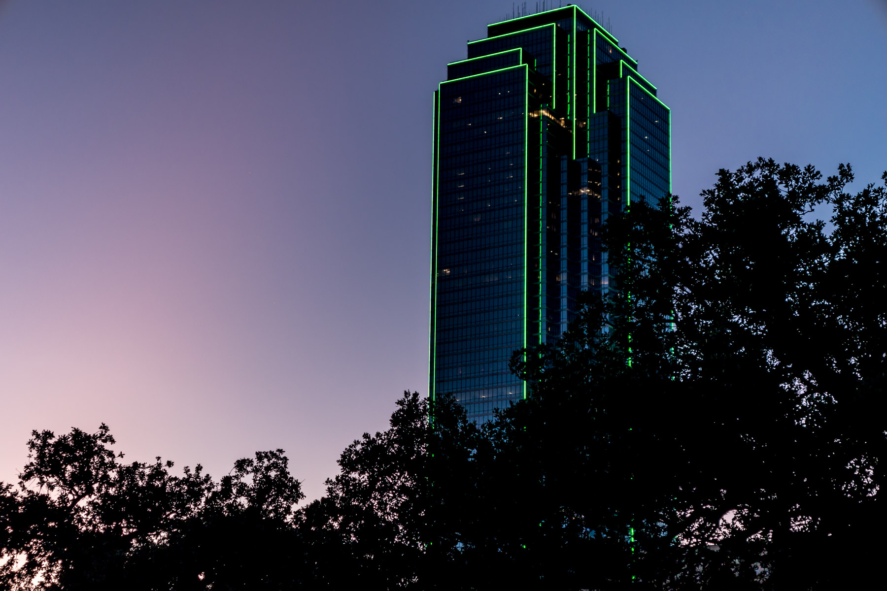 Dallas' Bank of America Plaza rises into the sky as the sun sets on North Texas.