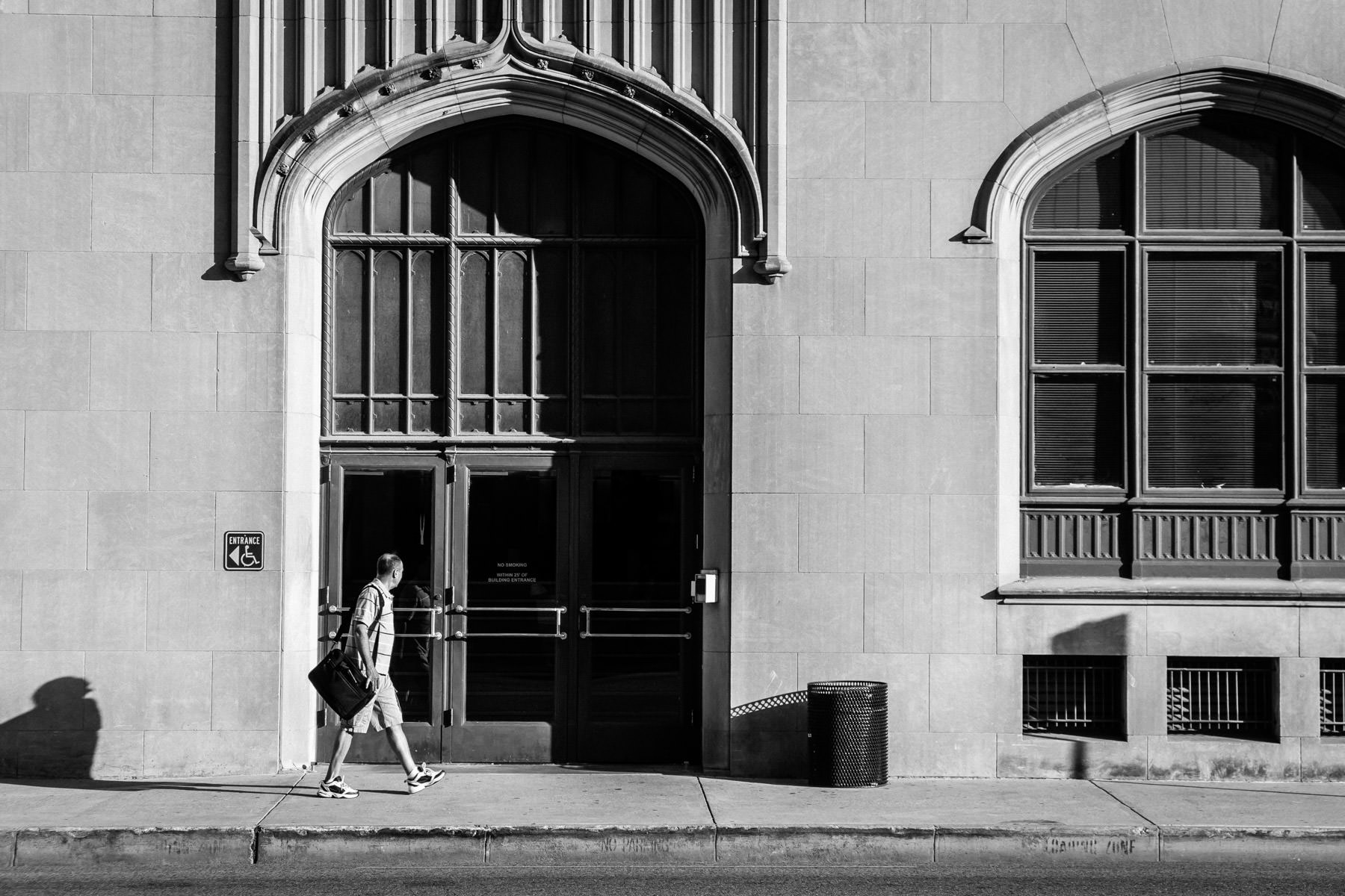 A pedestrian walks past the entrance to the Dallas County Records Building in Downtown Dallas.