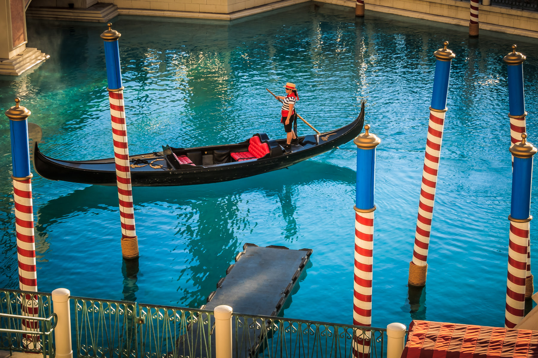 A gondolier steers her boat through the outdoor lagoon at The Venetian, Las Vegas.