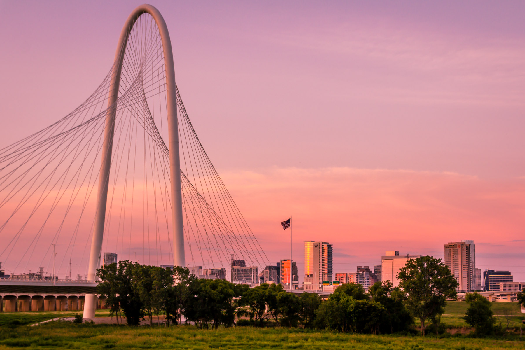 The sun sets on the Santiago Calatrava-designed Margaret Hunt Hill Bridge and Dallas' Uptown neighborhood.