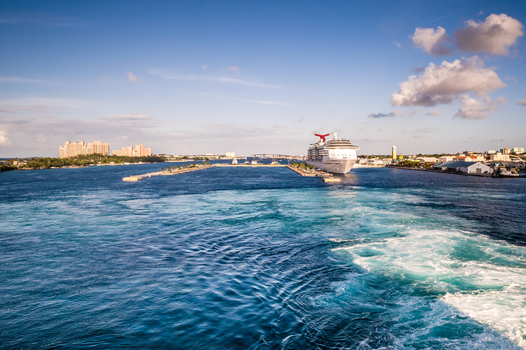 Nassau, Bahama's harbor, as seen from the deck of the cruise ship Carnival Magic as she sets sail, leaving behind her sister ship the Carnival Pride.