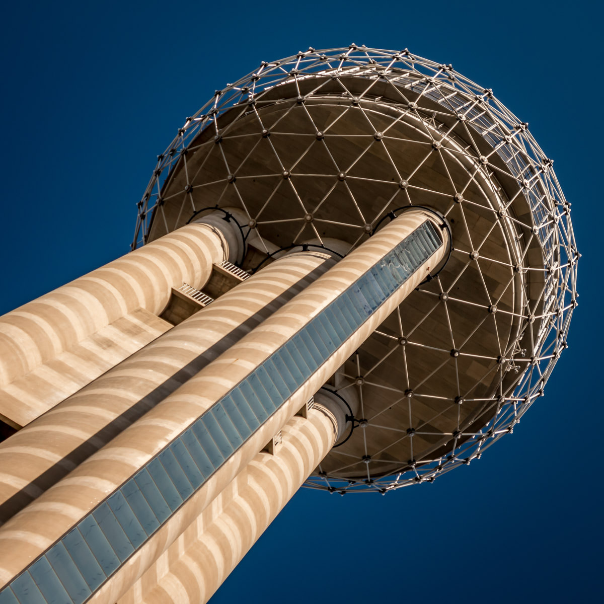 The top of Dallas' Reunion Tower resembles a giant steel dandelion seed head rising into the clear blue sky over North Texas.