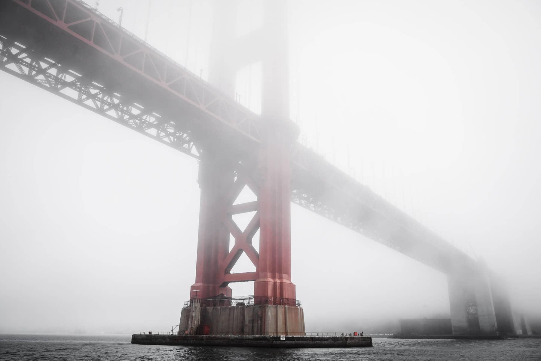 Fog envelops San Francisco's iconic Golden Gate Bridge.