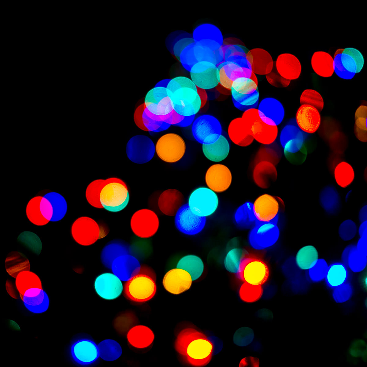 An abstraction of Christmas lights on a tree in Dallas' Klyde Warren Park.