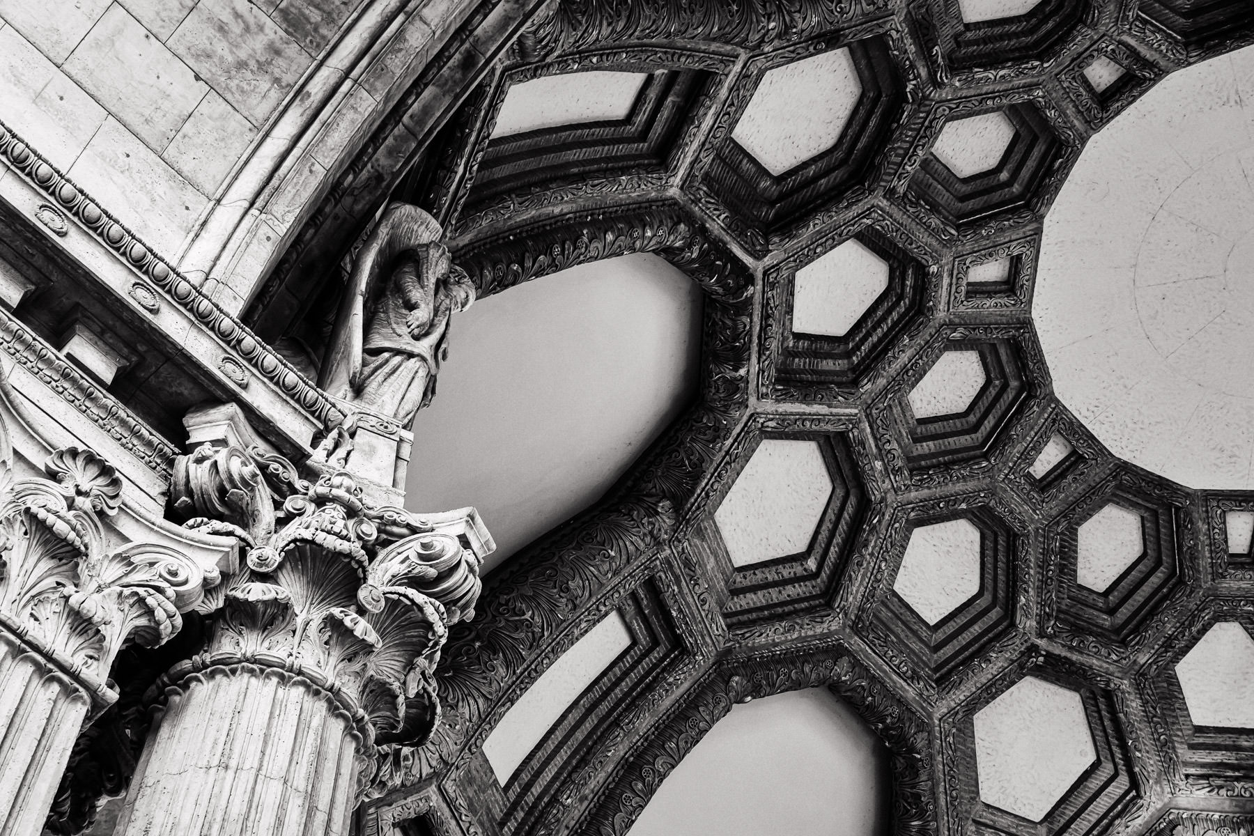 A statue watches over the space under the rotunda of San Francisco's Palace of Fine Arts.