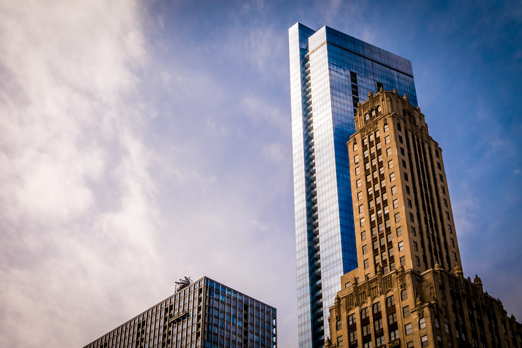 Chicago's 72-story Legacy Tower—completed in 2009—dwarfs nearby Willoughby Tower (1929) and Mid-Continental Plaza (1972).