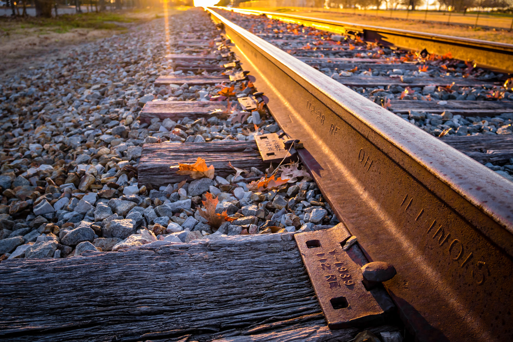 The sun sets on train tracks running through Addison, Texas.