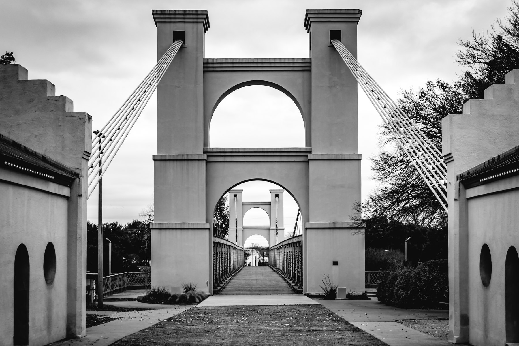 The Waco Suspension Bridge, built in 1869 and spanning 475 feet, reaches over the Brazos River in Waco, Texas.
