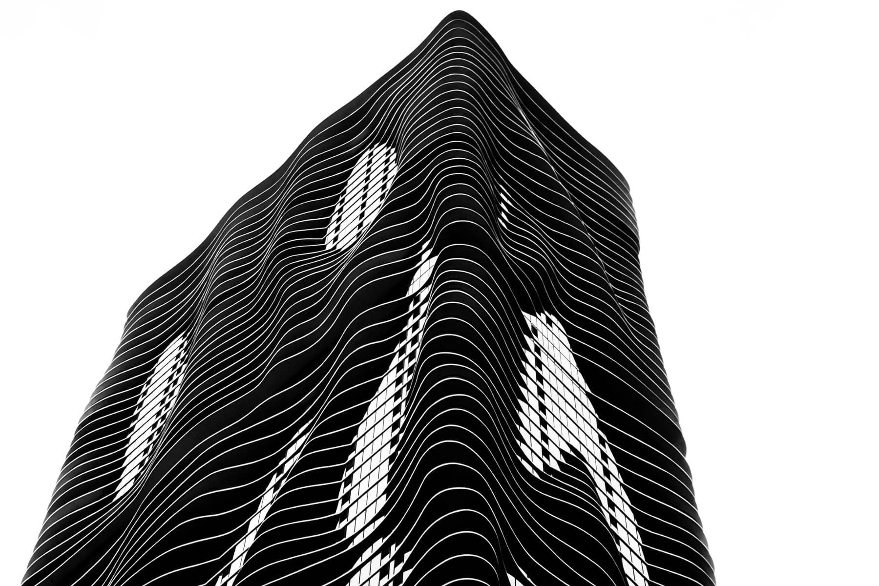 A minimalist architectural study of the undulating, irregular exterior of Chicago's 84-story-tall Aqua skyscraper.
