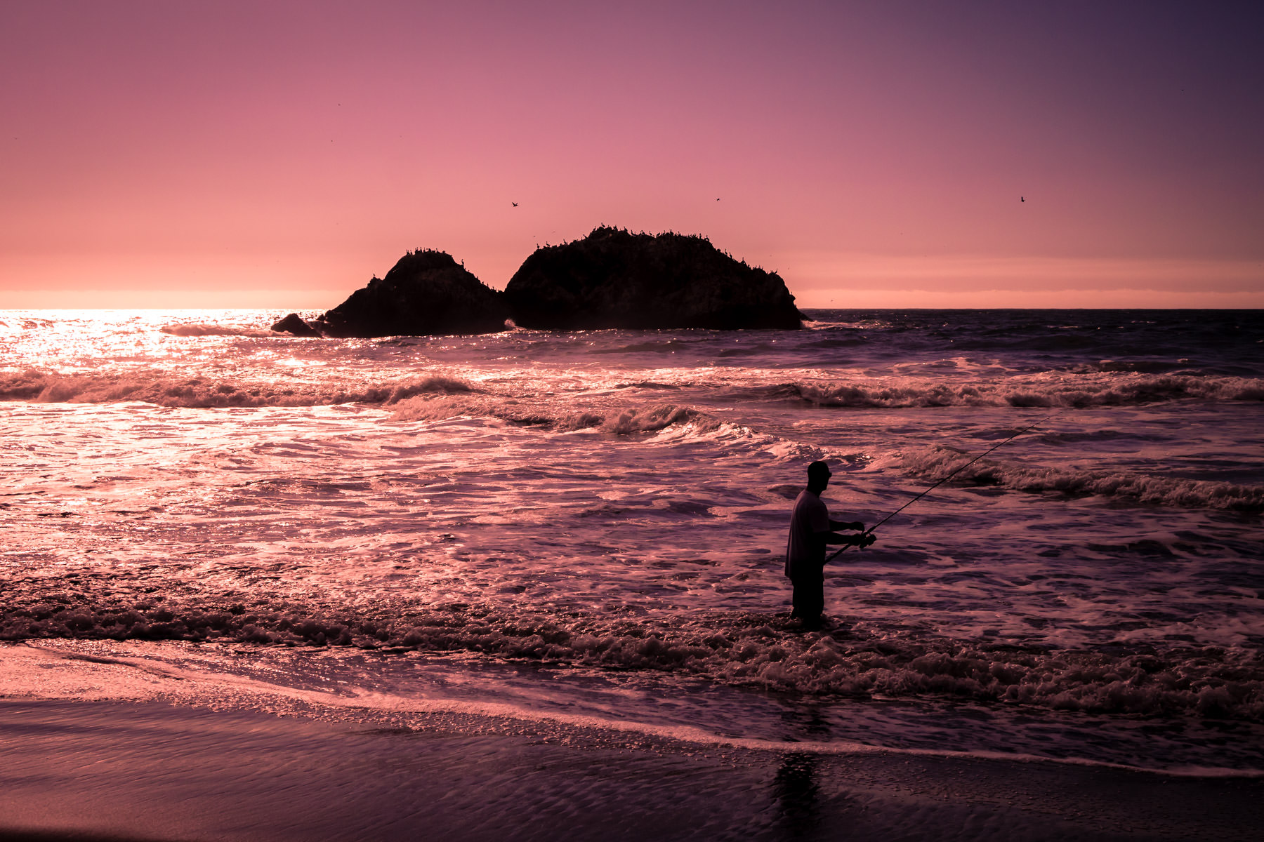 A fisherman tries his luck as the sun sets on the Pacific Ocean at San Francisco's Lands End.