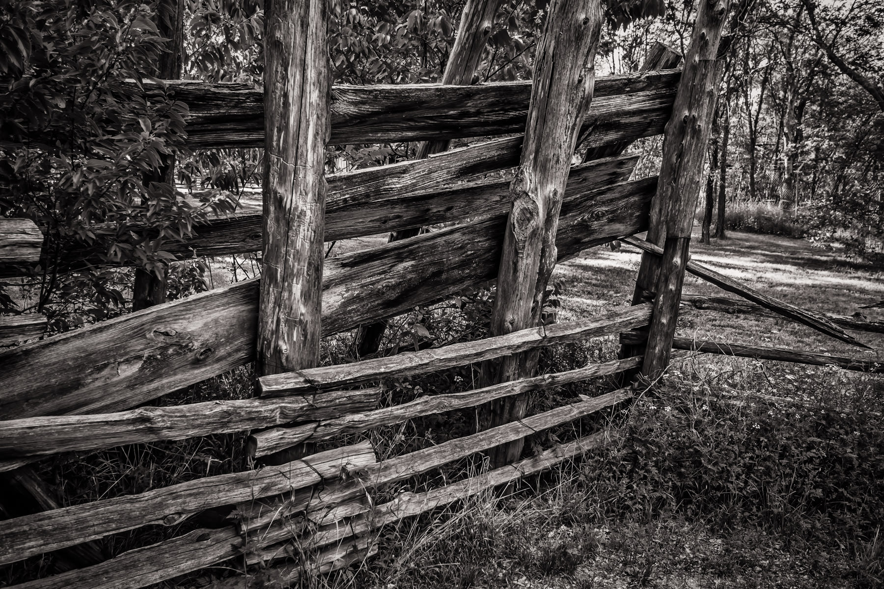 A dilapidated wooden fence at Texas' Cedar Hill State Park's Penn Farm.