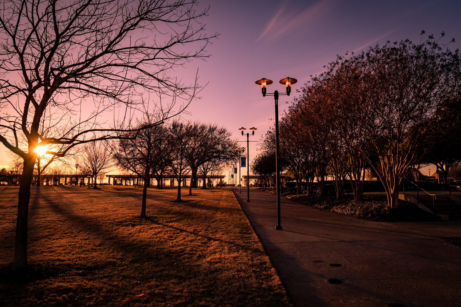 The sun sets on Addison Circle Park in Addison, Texas.