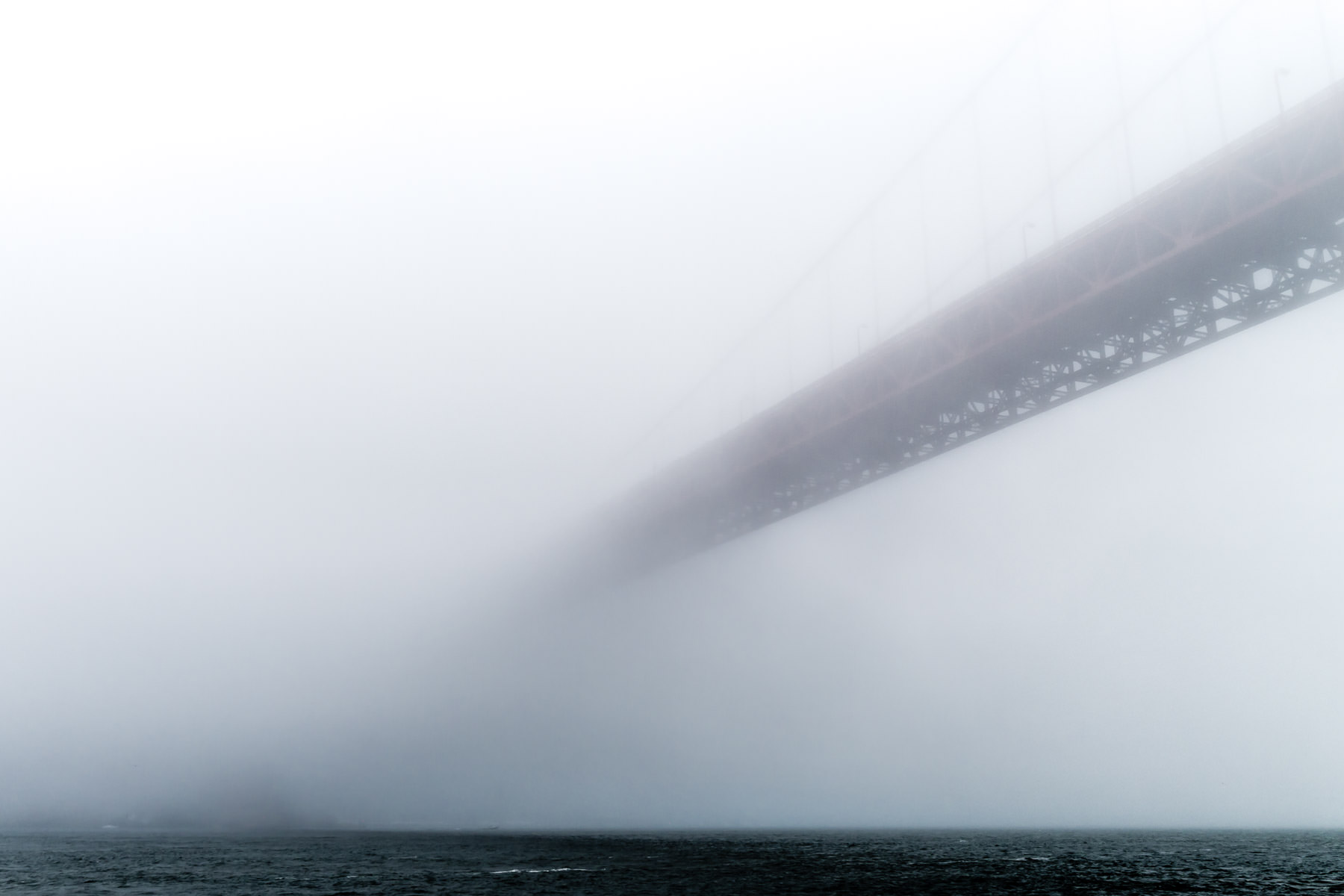 Fog on San Francisco Bay swallows the city's iconic Golden Gate Bridge.