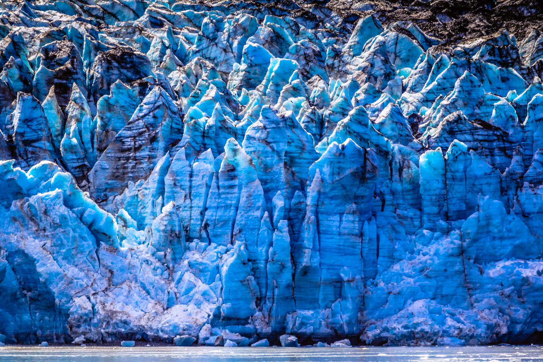 The icy face of Alaska's Margerie Glacier rises over 250 feet into the air at Glacier Bay National Park.