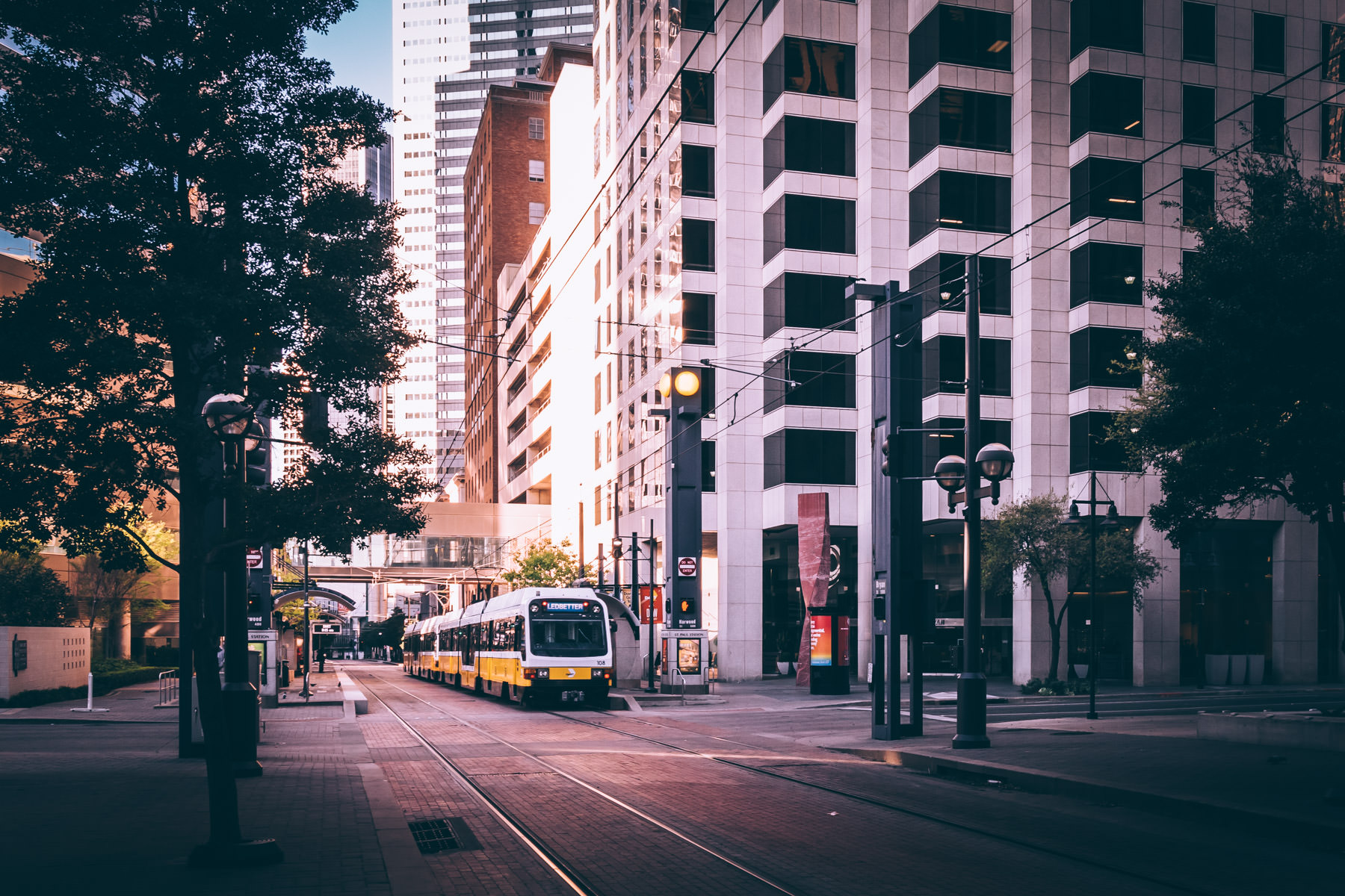 A DART Light Rail Blue Line train transits through Downtown Dallas.