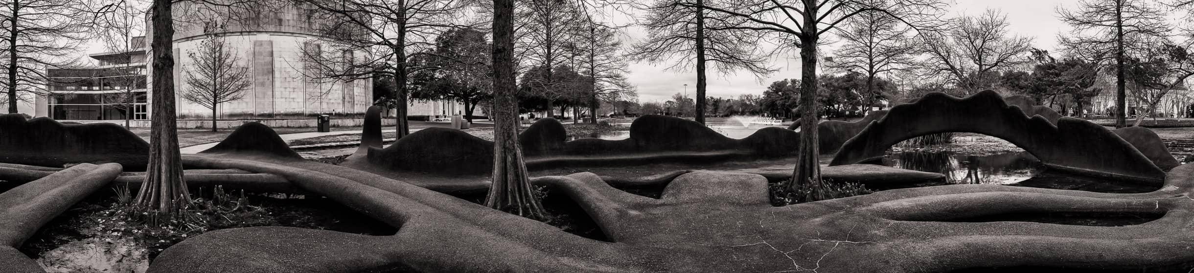 Artist Pat Johanson's serpentine sculptures snake and undulate through Leonhardt Lagoon in Dallas' Fair Park.