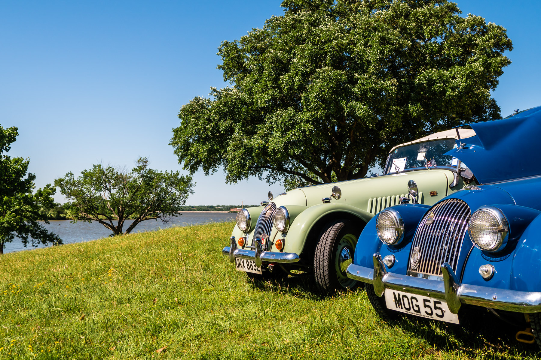 A pair of Morgans on sit on a hill overlooking Dallas' White Rock Lake during All British and European Car Day.