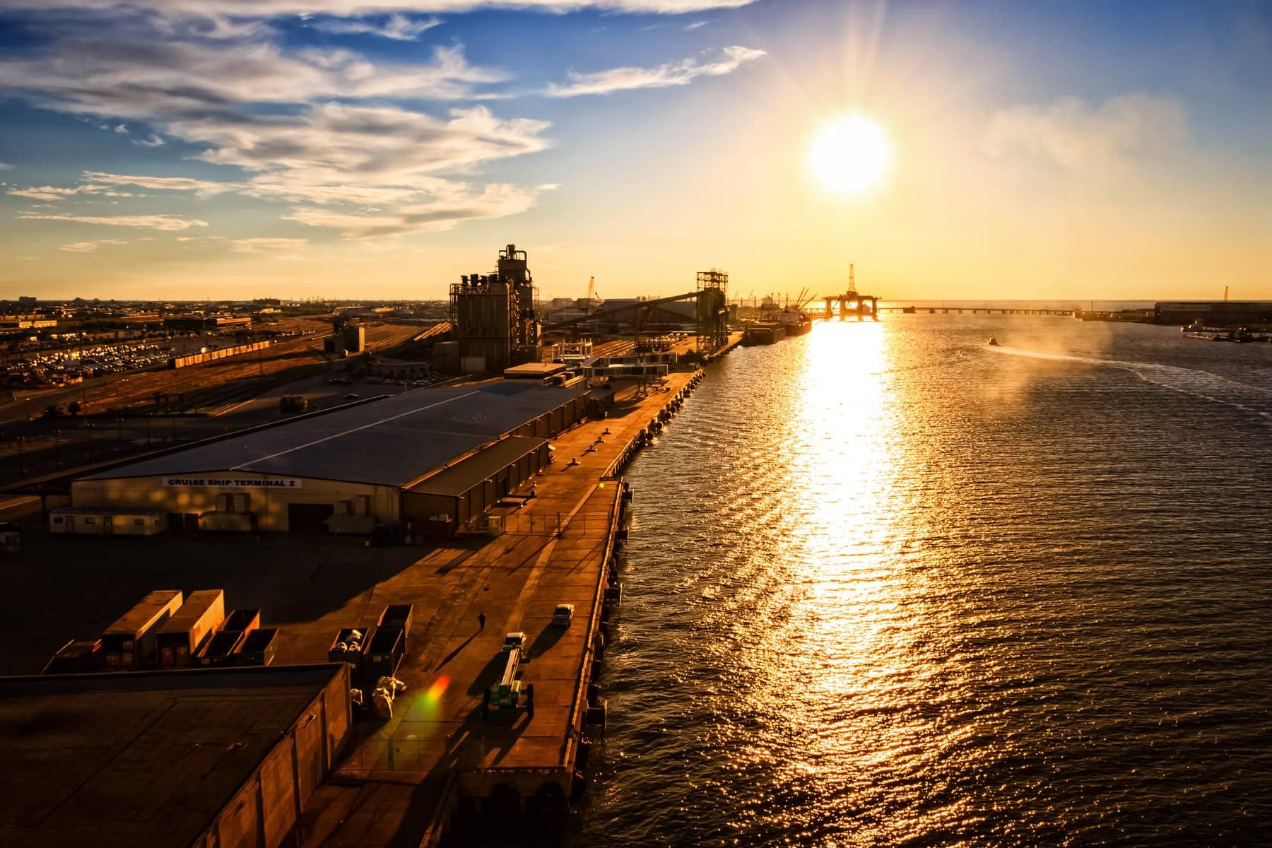 The Port of Galveston is illuminated by the sun setting along the Texas Coast.