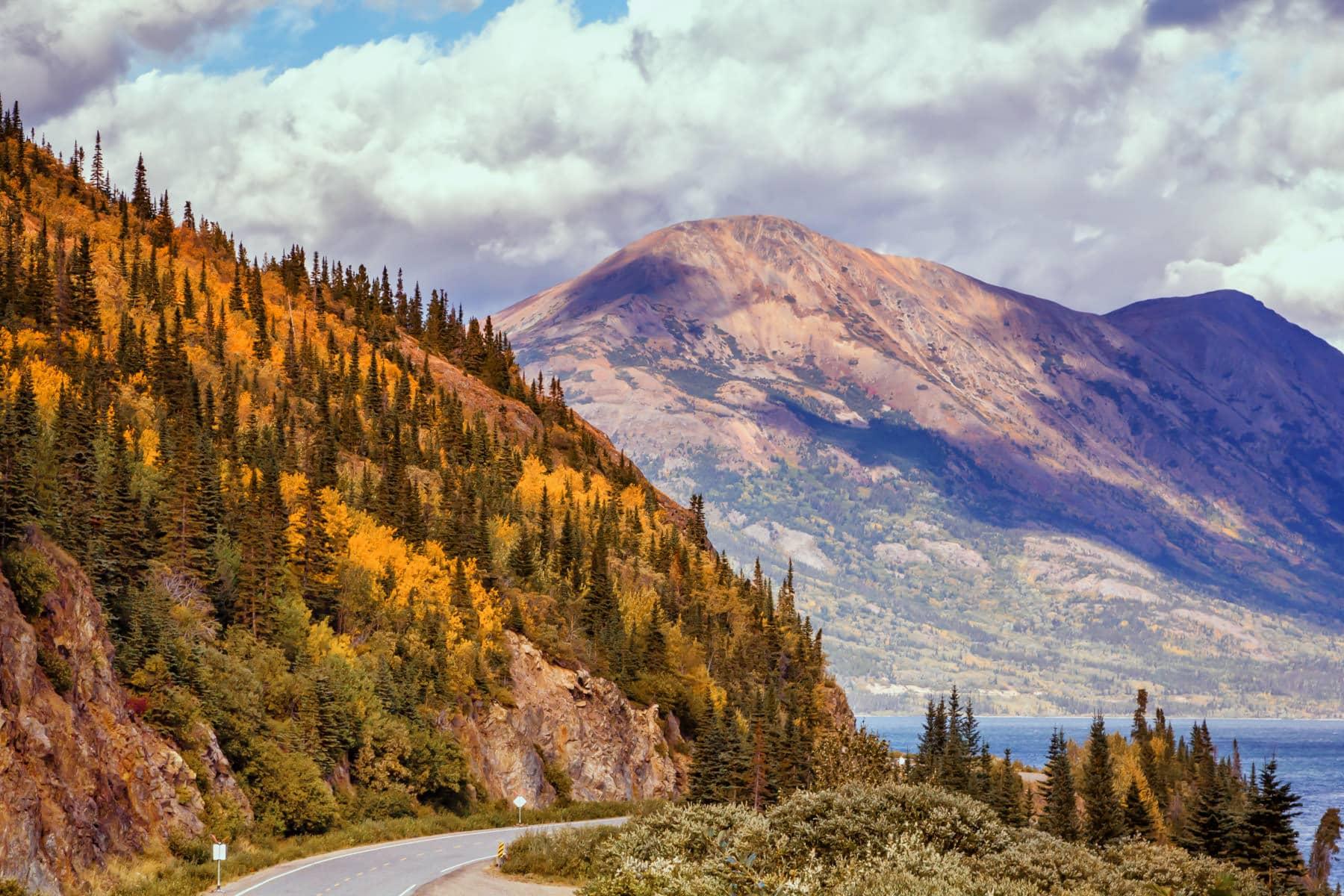 The Klondike Highway creeps around mountains along the shore of Tutshi Lake in British Columbia's Stikine Region.