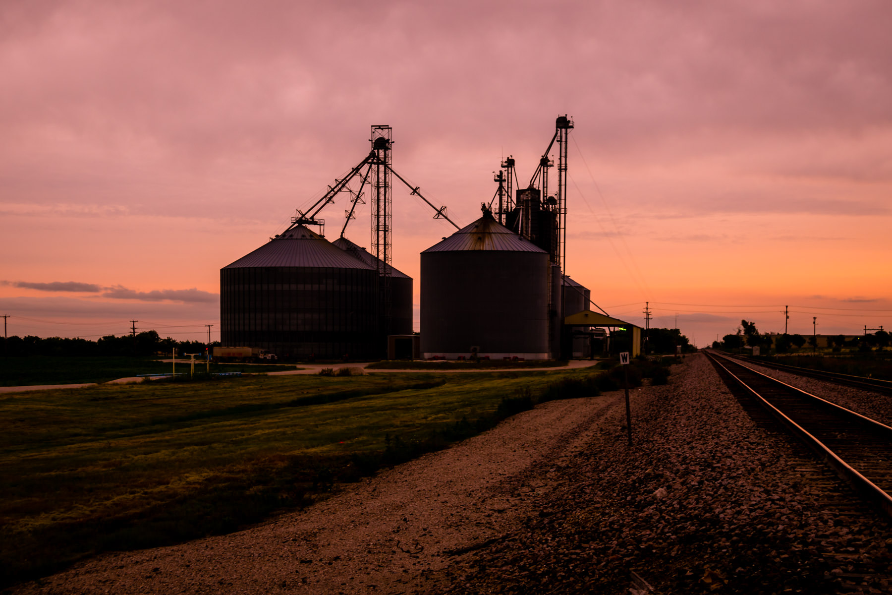 Silos in Prosper, Texas, are silhouetted by the rising sun.