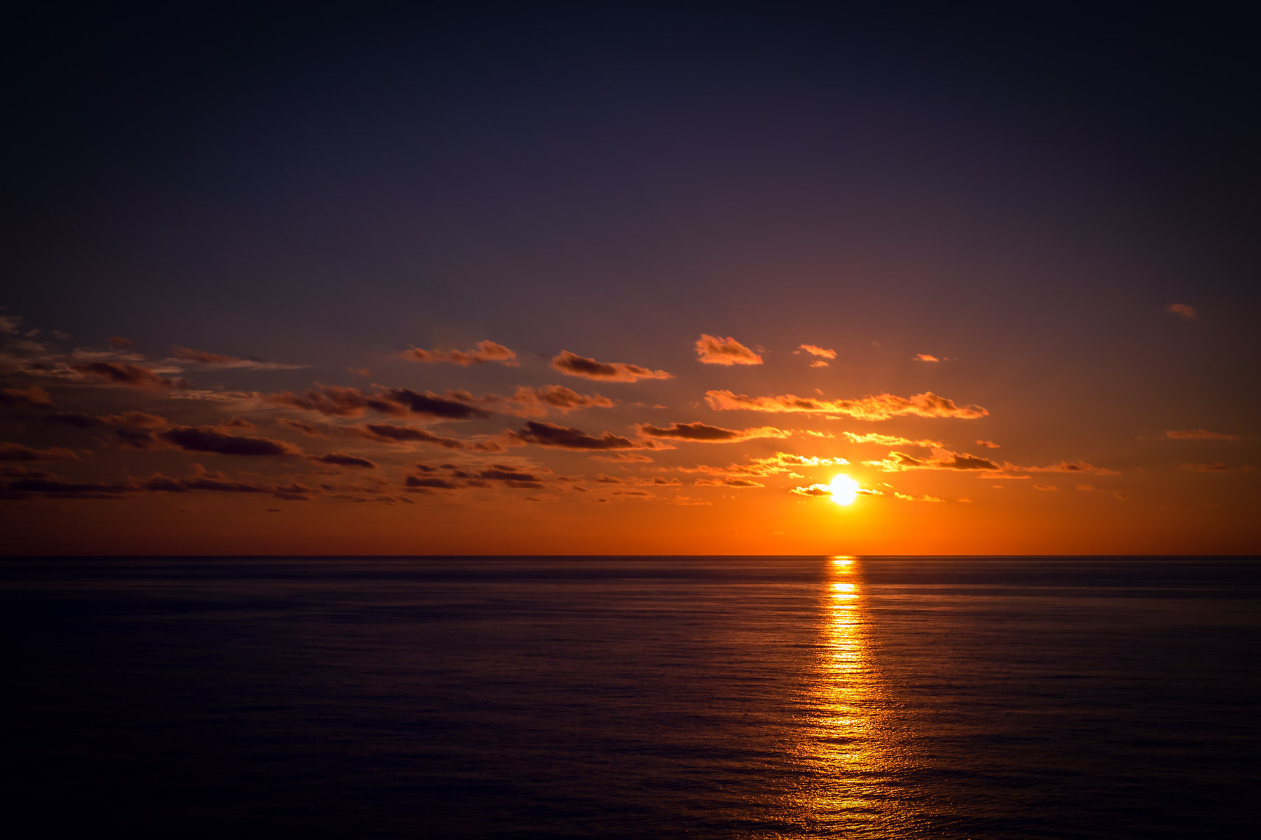 The sun sets on the Gulf of Mexico, somewhere south of Louisiana,