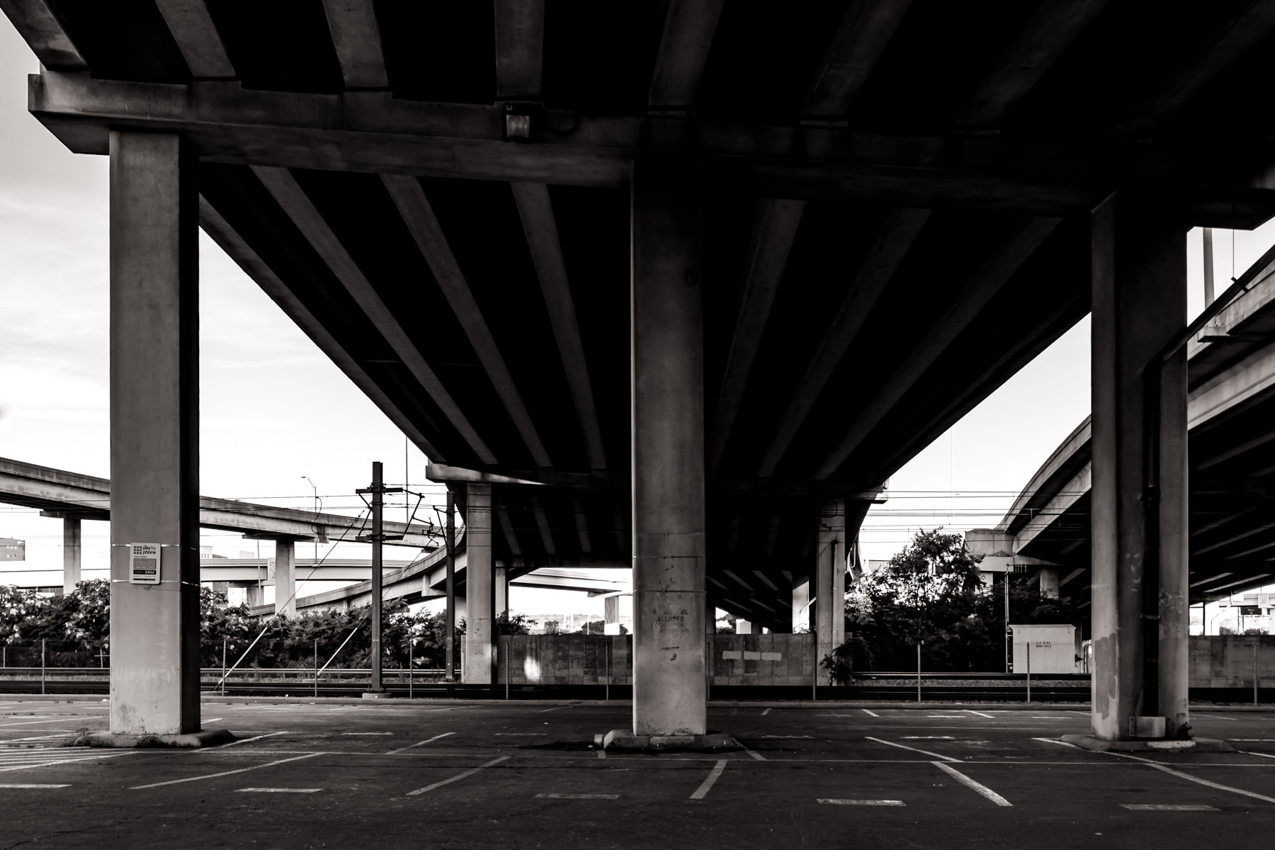 Support columns hold up the main lanes and a ramp of the Woodall Rogers Freeway, Dallas.