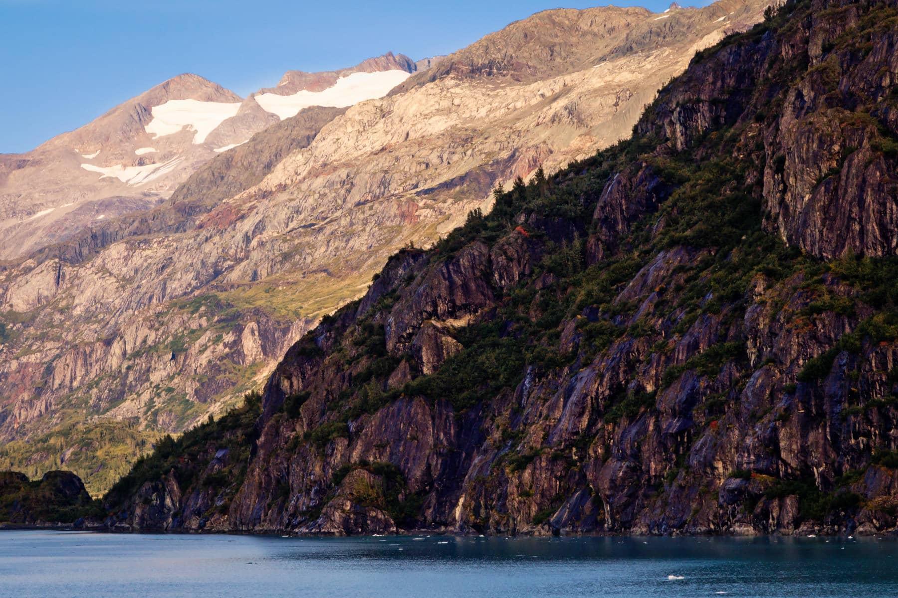 Mountains rise along the shore of Alaska's Glacier Bay.