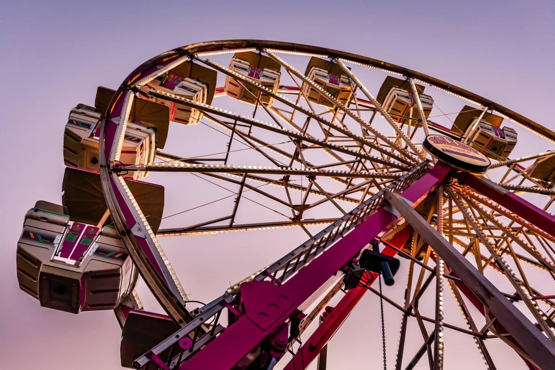 A ferris wheel rises into the evening sky at Addison, Texas' Taste Addison festival.