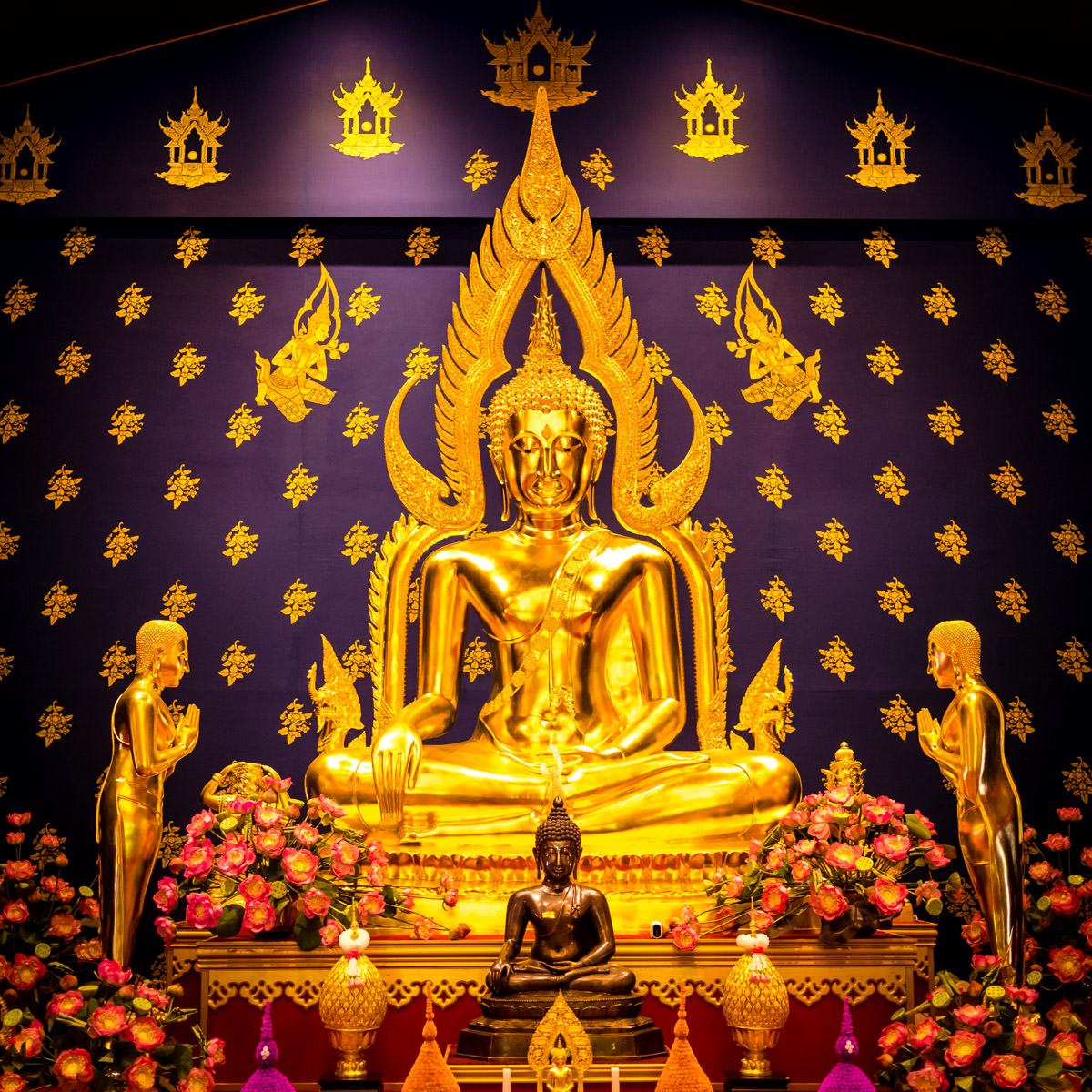 A gold statue of the Buddha in the shrine at the Buddhist Center of Dallas.
