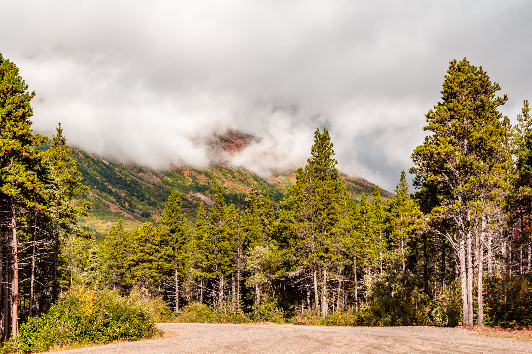 Low clouds roll over a mountain near the shore of Tutshi Lake in British Columbia's Stikine Region.