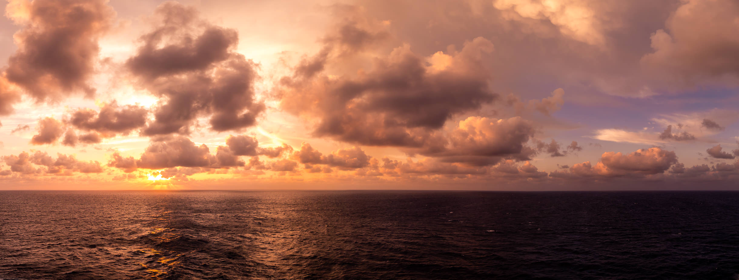 The morning sun shines through the clouds somewhere in the Gulf of Mexico.