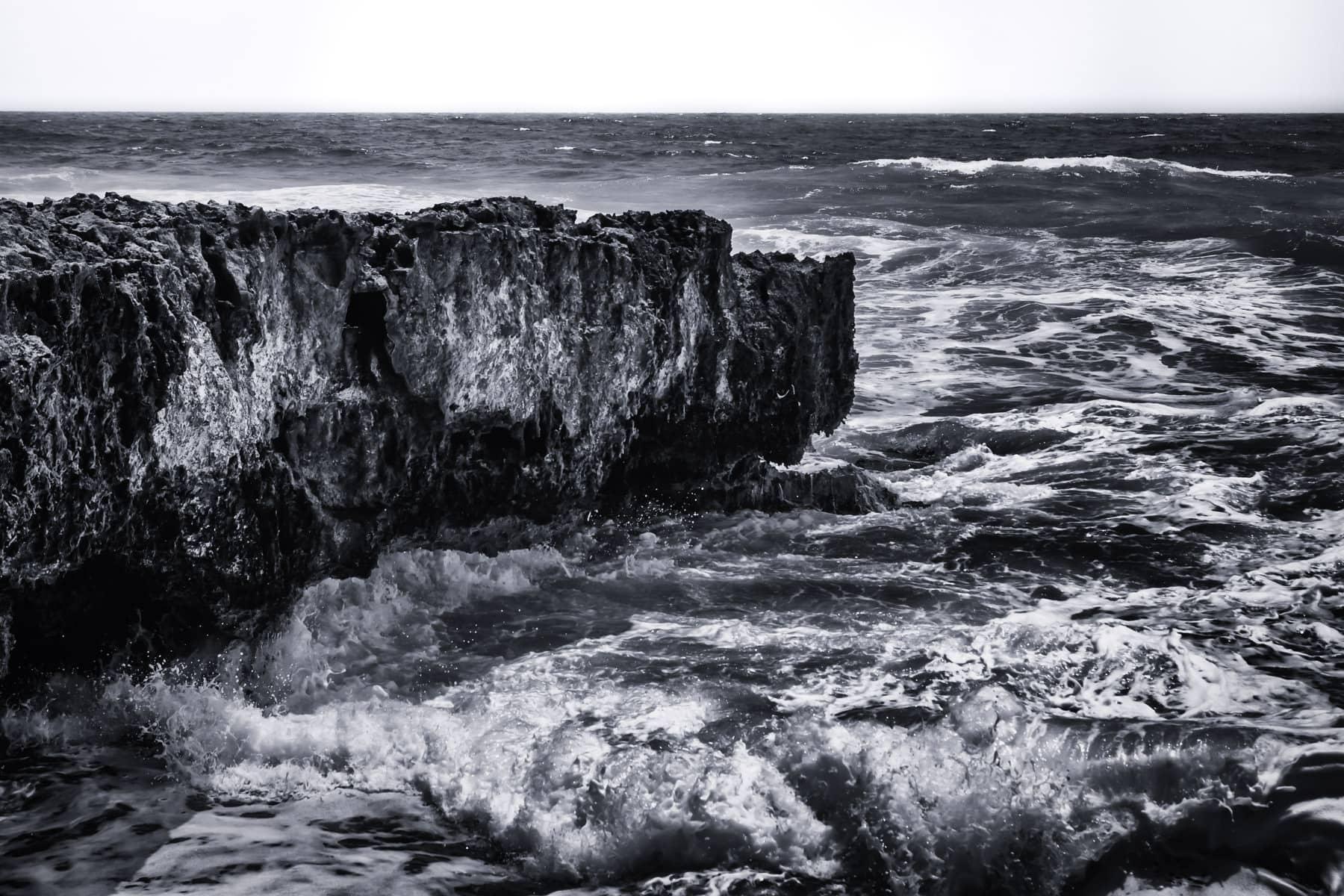 Waves crash upon the rocky shore at El Mirador on the southeast coast of Cozumel, Mexico.