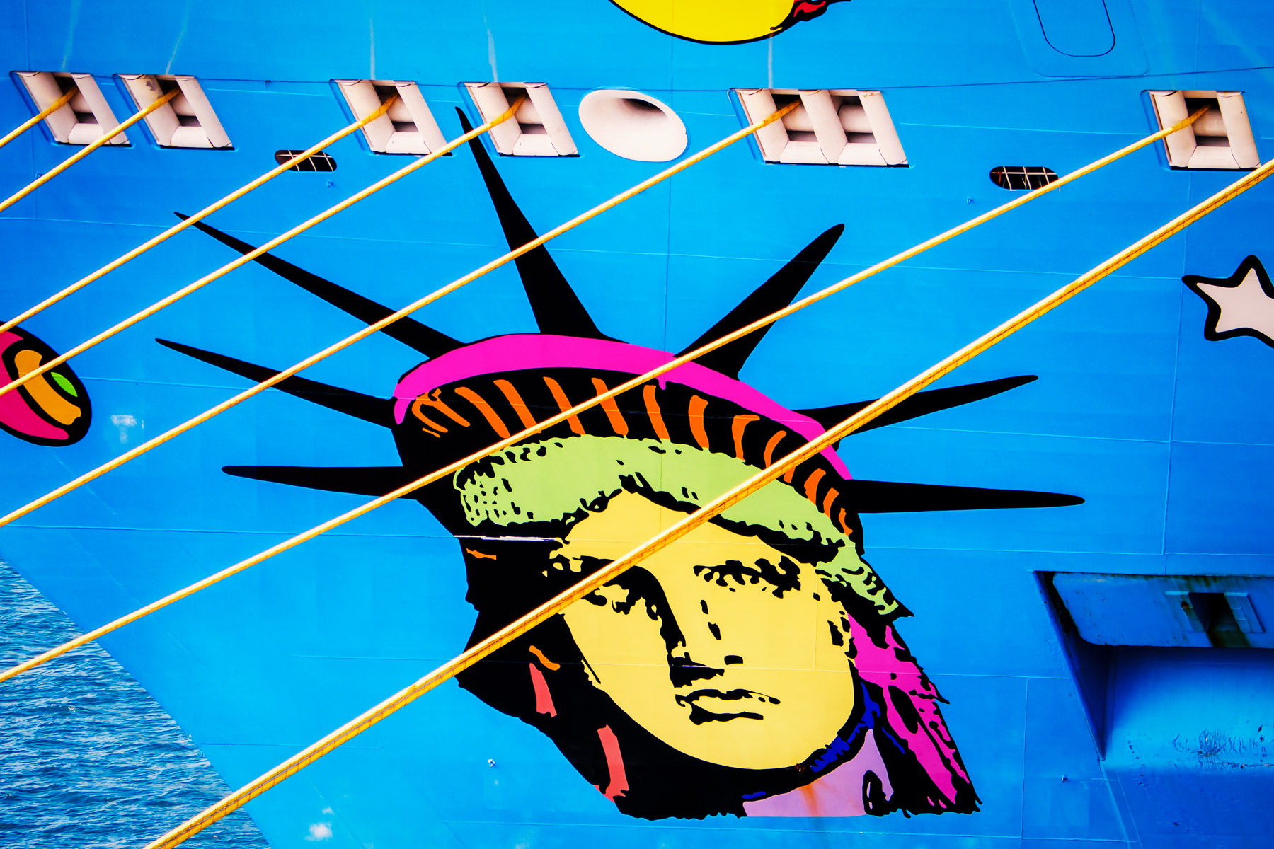 The stylized Statue of Liberty graphic that graces the bow of the cruise ship Norwegian Breakaway, spotted docked in Nassau, Bahamas.