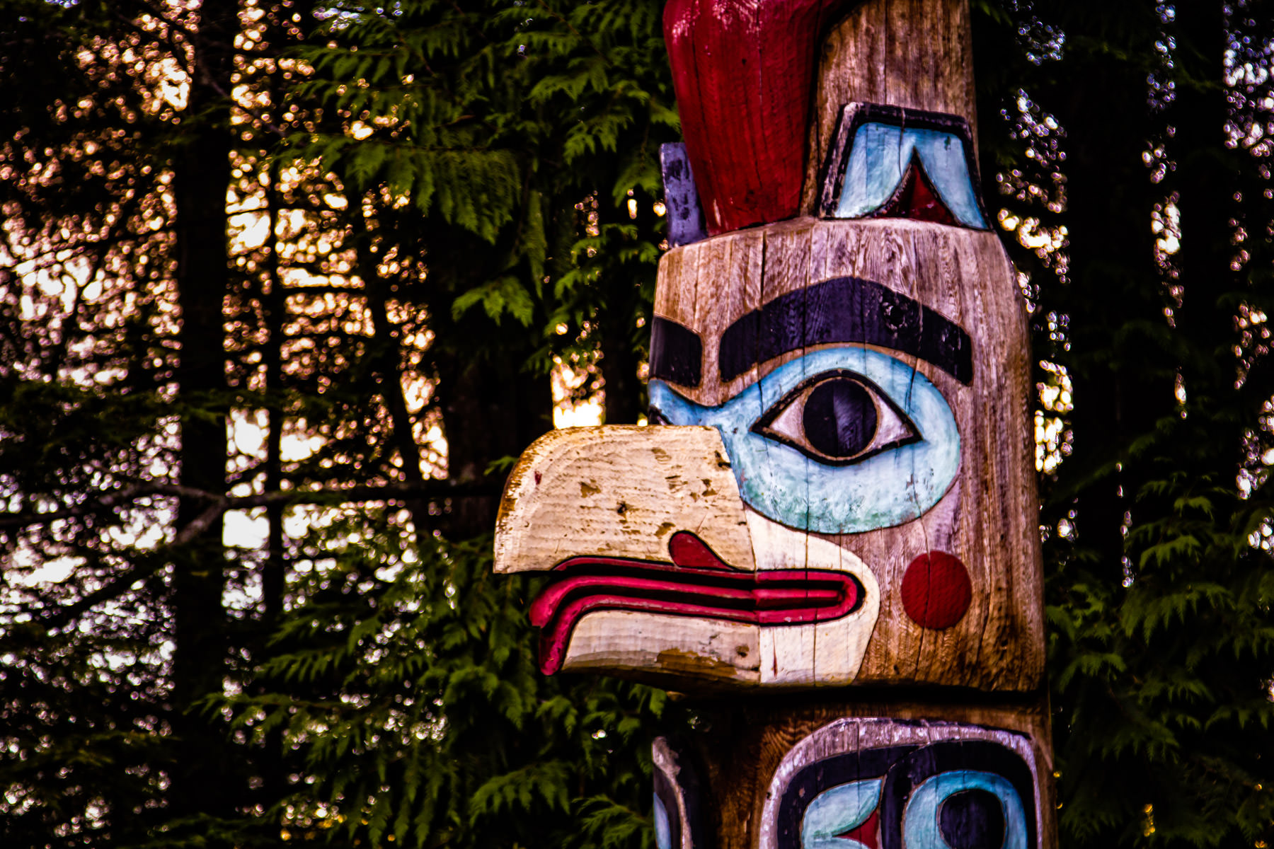 Detail of a totem pole at Totem Bight State Historical Park in Ketchikan, Alaska. This pole represents Raven-at-the-Head-of-Nass, from whom Raven stole daylight