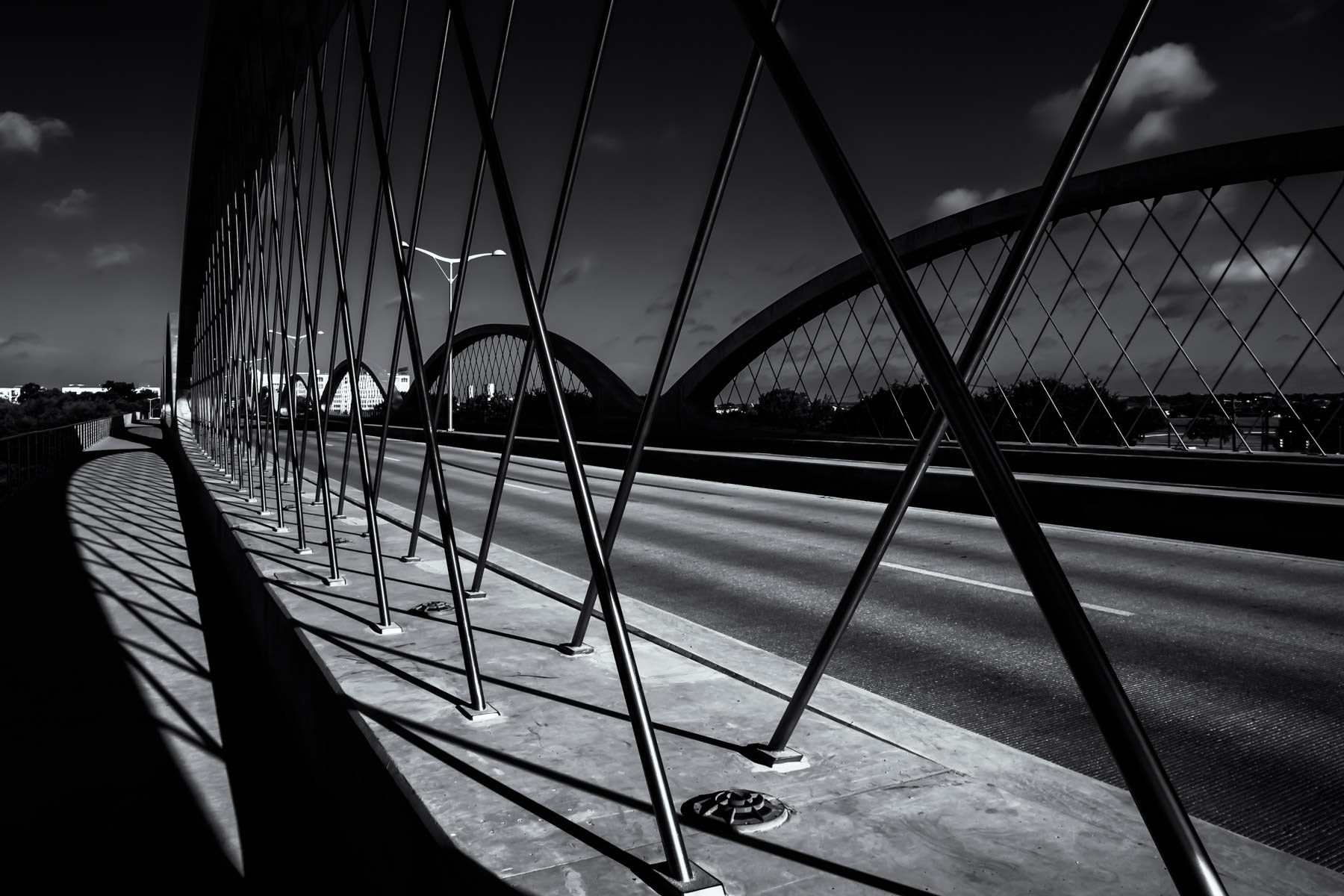 The arches of Fort Worth, Texas' iconic West Seventh Street Bridge undulate into the distance.