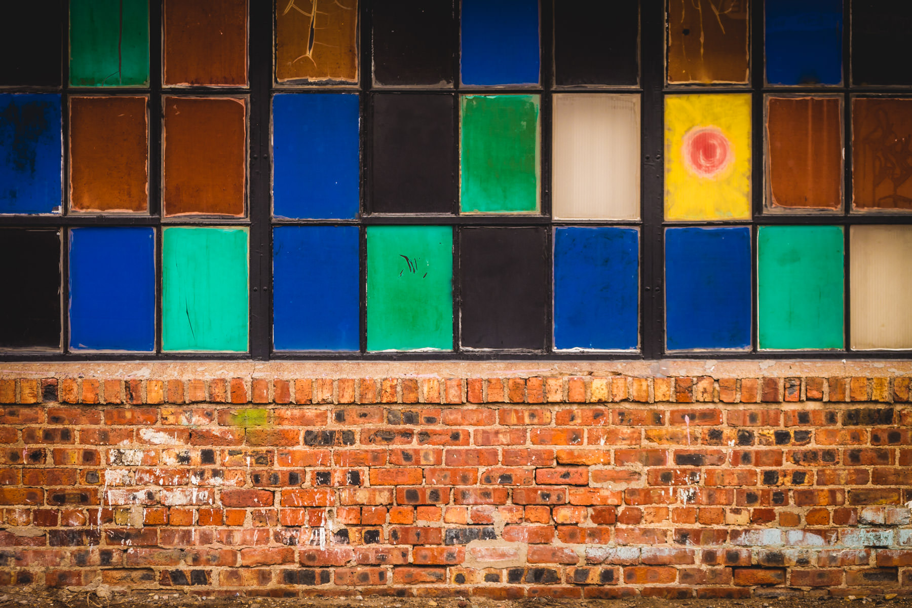 Multi-colored window panes spotted on a building in Dallas' Deep Ellum neighborhood.