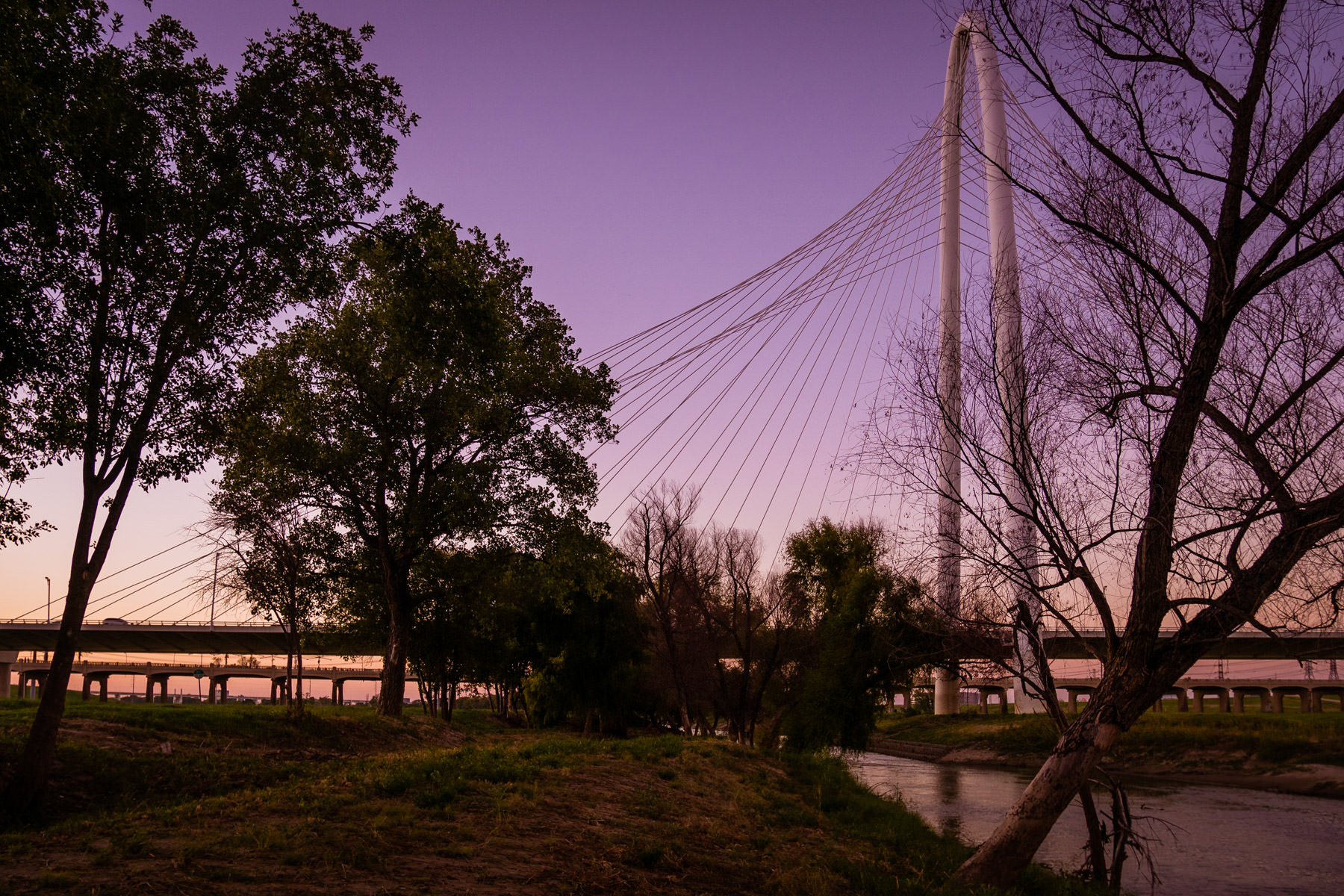 The sun sets on Dallas' Santiago Calatrava-designed Margaret Hunt Hill Bridge.