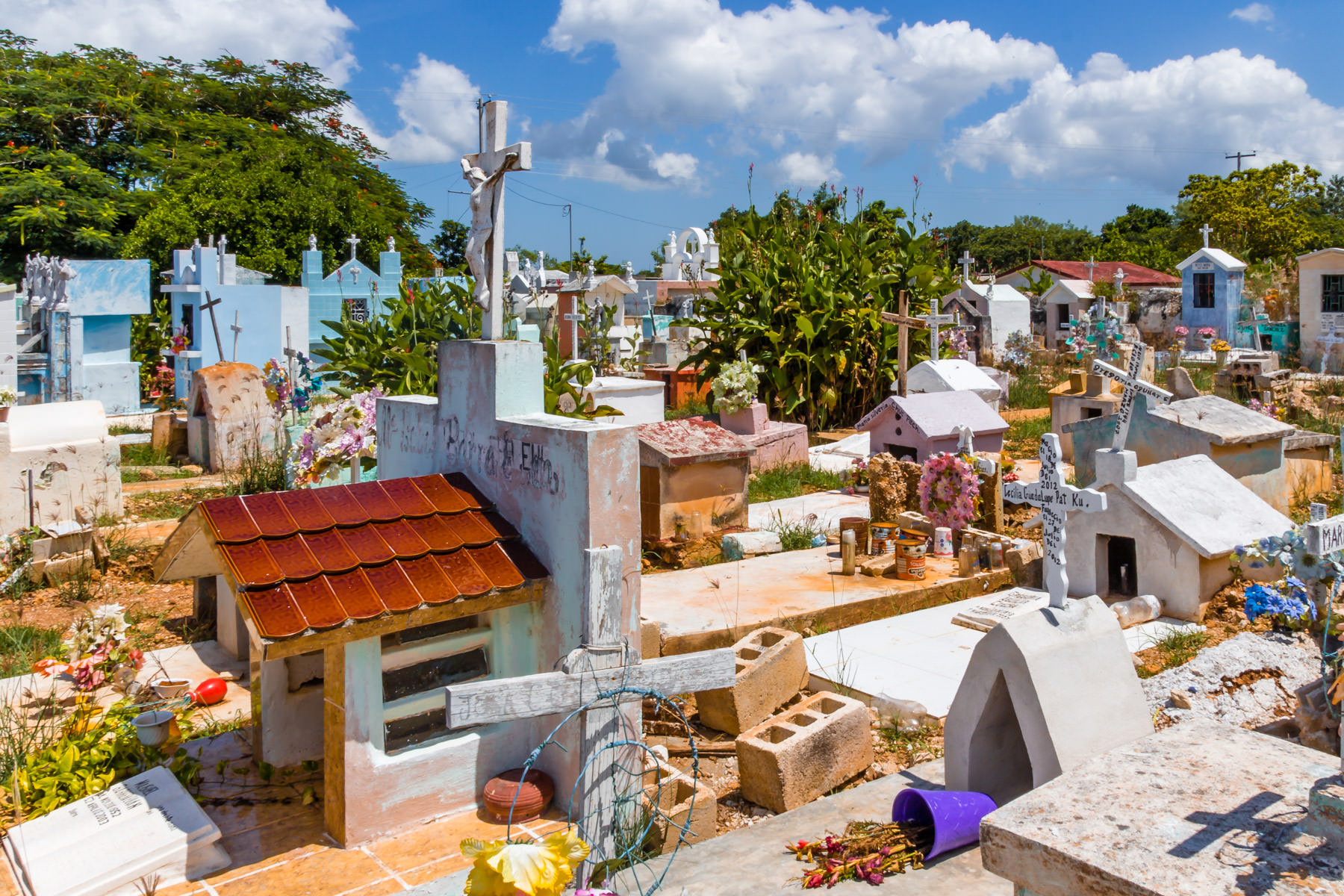 Colorful graves in a cemetery in the small village of Dzemul, Yucatan, Mexico.