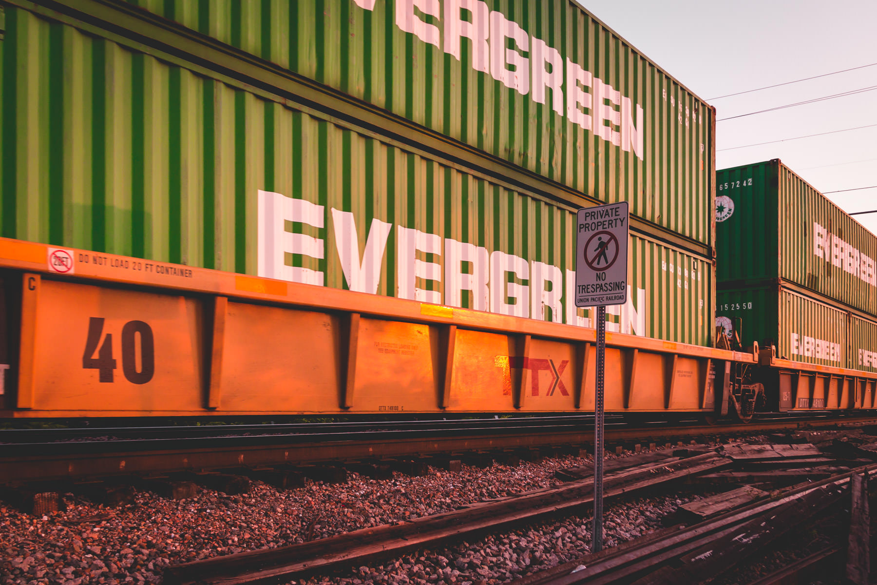Railcars laden with containers slowly rumble along West Dallas train tracks.
