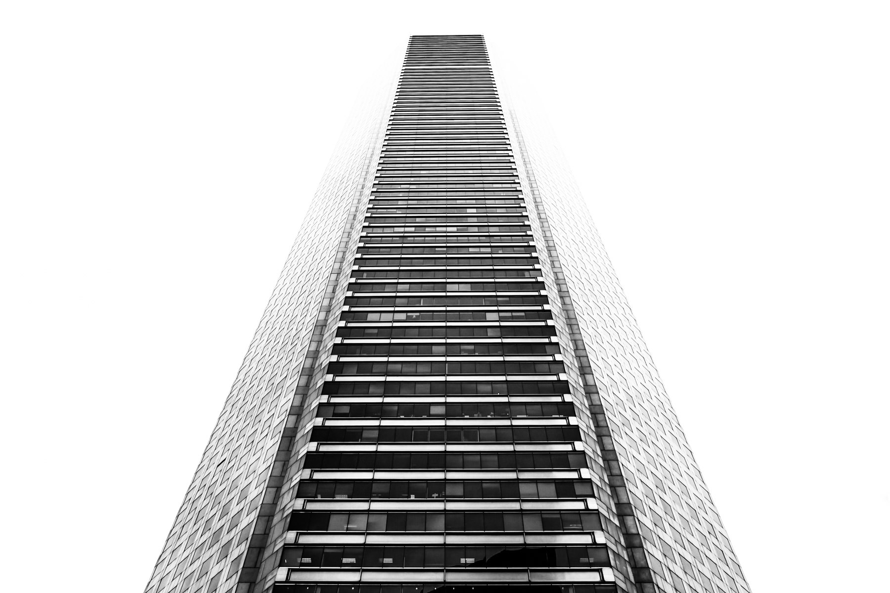 Houston's tallest skyscraper—the 1,002-foot-tall JPMorgan Chase Tower—rises into the overcast sky in the city's downtown.